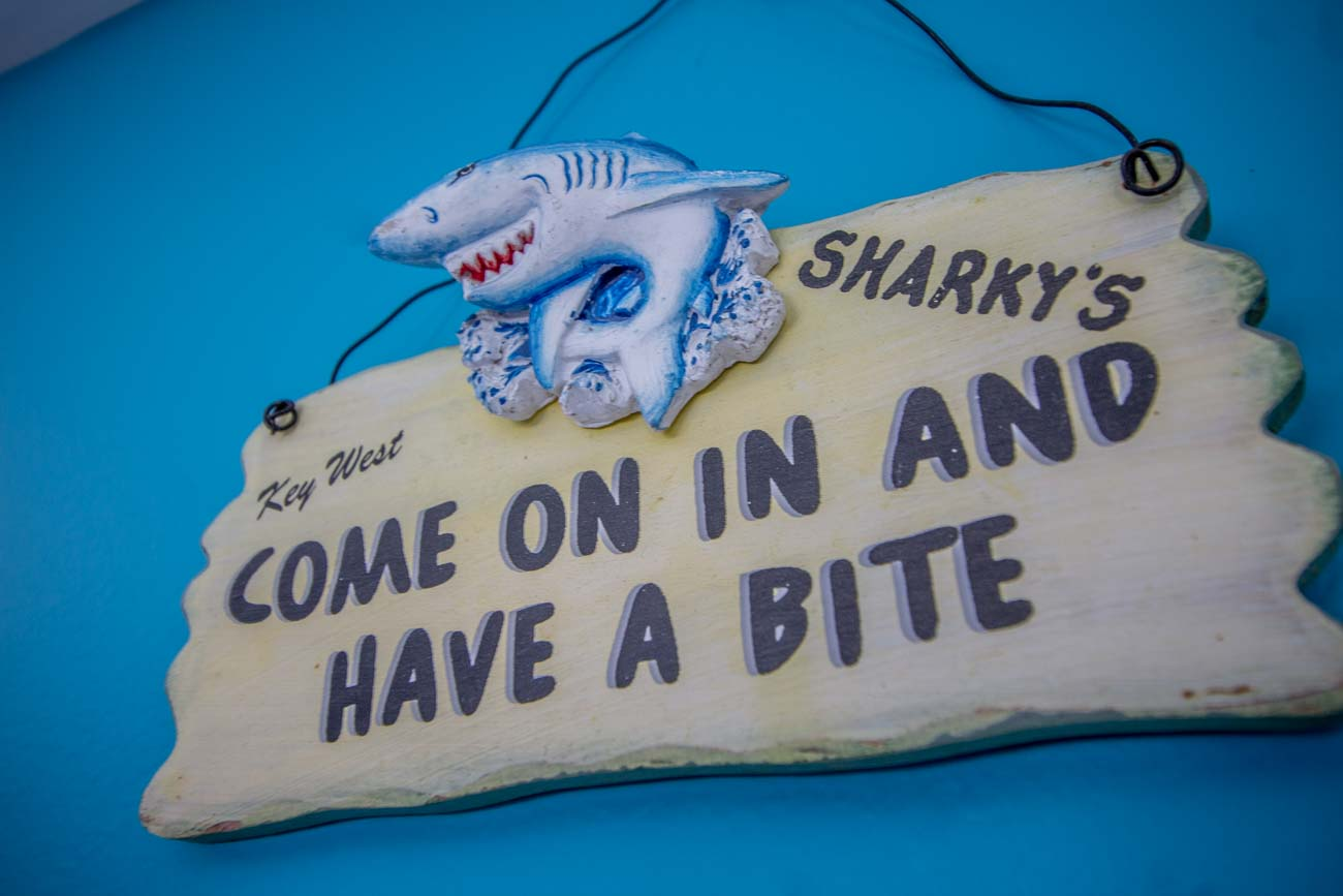 "Sharky's Artic Sweets & Eats is a friendly, nautical-themed takeout spot located off US 27 in Alexandria. Guests order through a takeout window at the front where they can expect everything to be served ready to order and at a very reasonable price. As a local favorite in the neighborhood for around 15 years, the eatery was originally called ""Sharky's"". Owner Emily Russell took over in February 2020 and reopened it in May after giving it a longer name and remodeling the space, which involved revamping its popular playground. ADDRESS: 9924 Alexandria Pike (41001) / Image: Katie Robinson, Cincinnati Refined // Published: 9.3.20"
