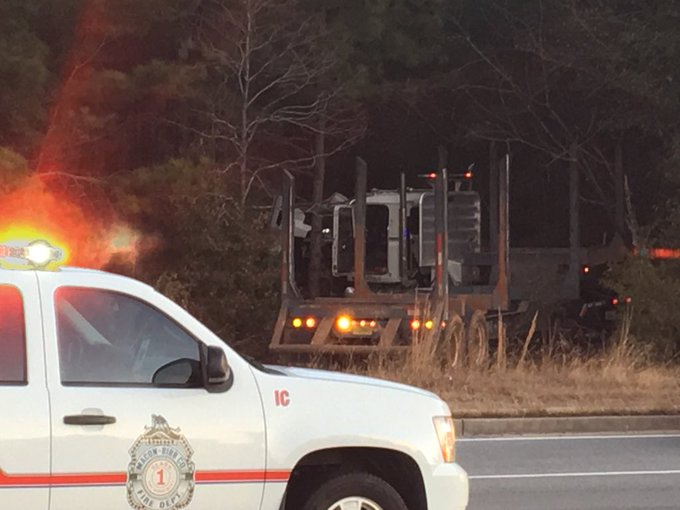 One man is dead after a two-vehicle accident involving a log truck on Shurling Drive in east Macon Friday morning/Ronshad Berry (WGXA)<p></p>