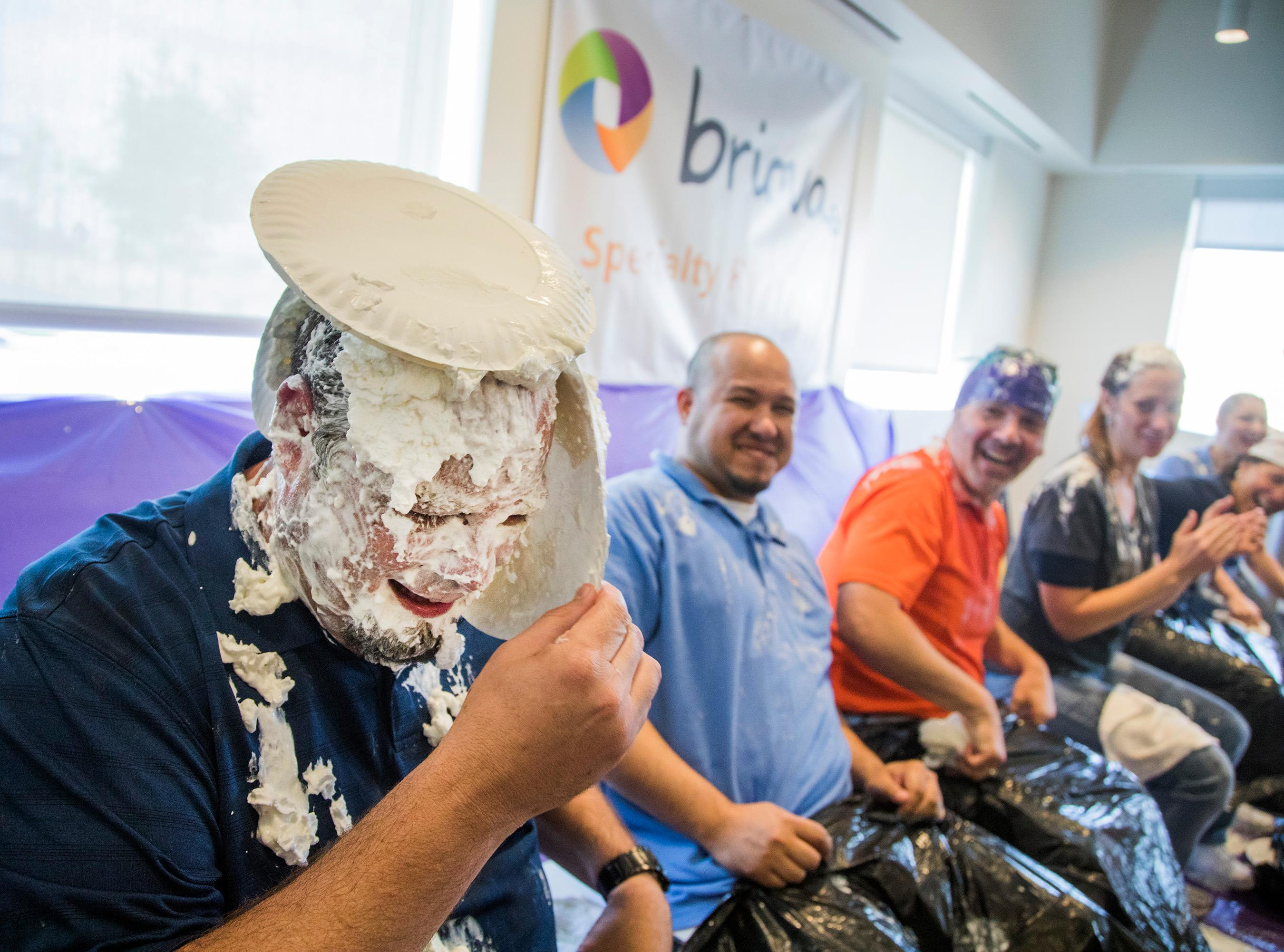 Optum leader Doug Larson gets pied in the face Wednesday, July 26, 2017, by employees to raise funds for the Southern Nevada Chapter of the Leukemia & Lymphoma Society and recruit people to participate in its 2017 Light the Night walk in November. (Photo courtesy of Jeff Scheid)