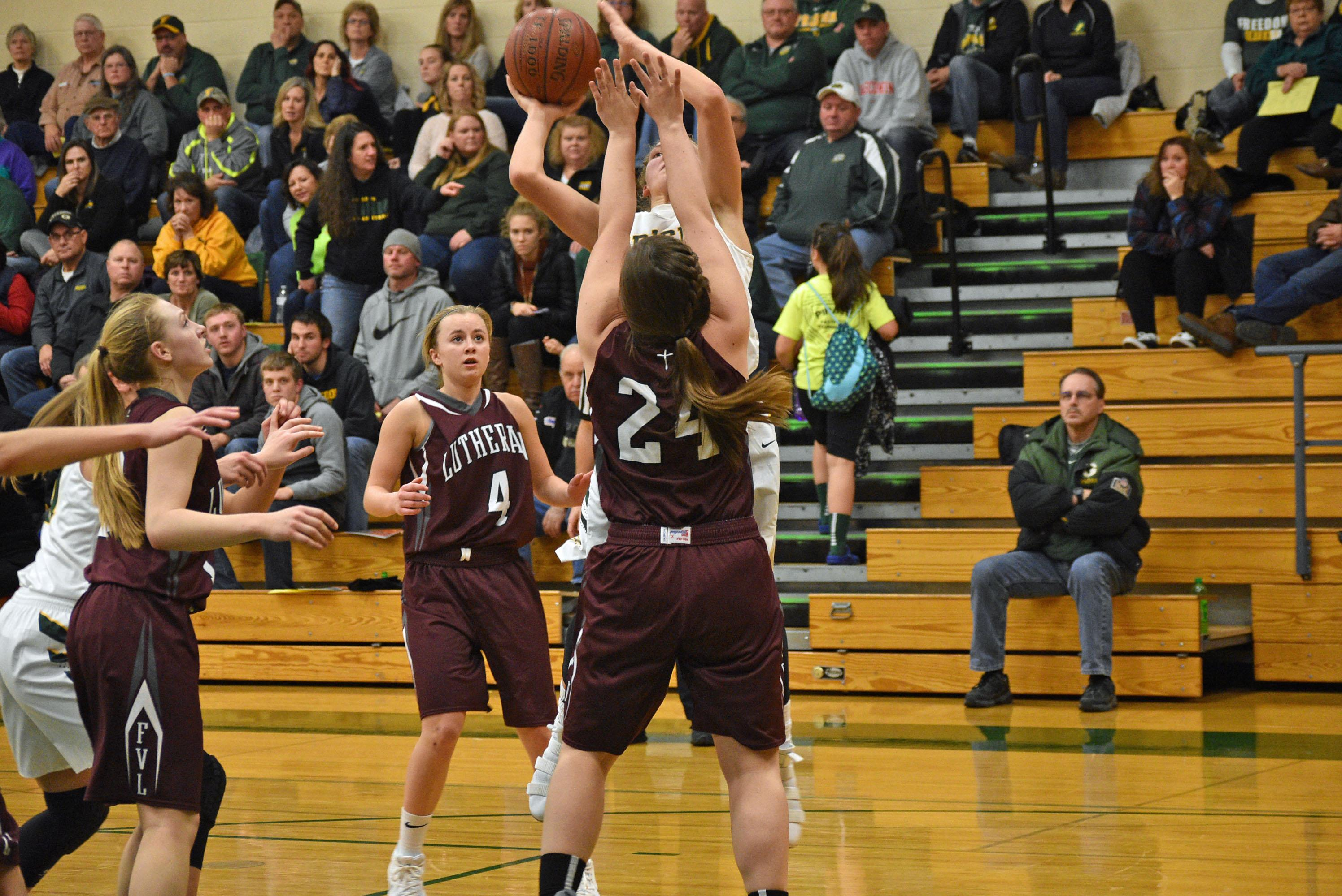 Fox Valley Lutheran beat Freedom, 57-50, in double overtime in a North Eastern Conference girls basketball game on Tuesday night. (Doug Ritchay/WLUK)