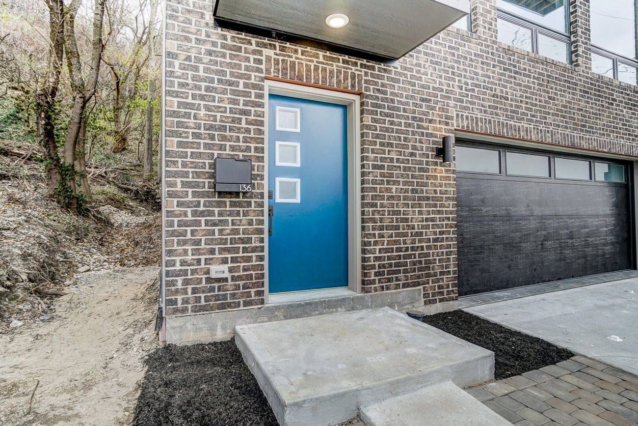 """Look for the one with the blue door"" you'll say to your friends who are coming over for the first time since you purchased 136 Dorsey Street. / Image courtesy of Kelly Gibbs, Coldwell Banker // Published: 12.28.18"