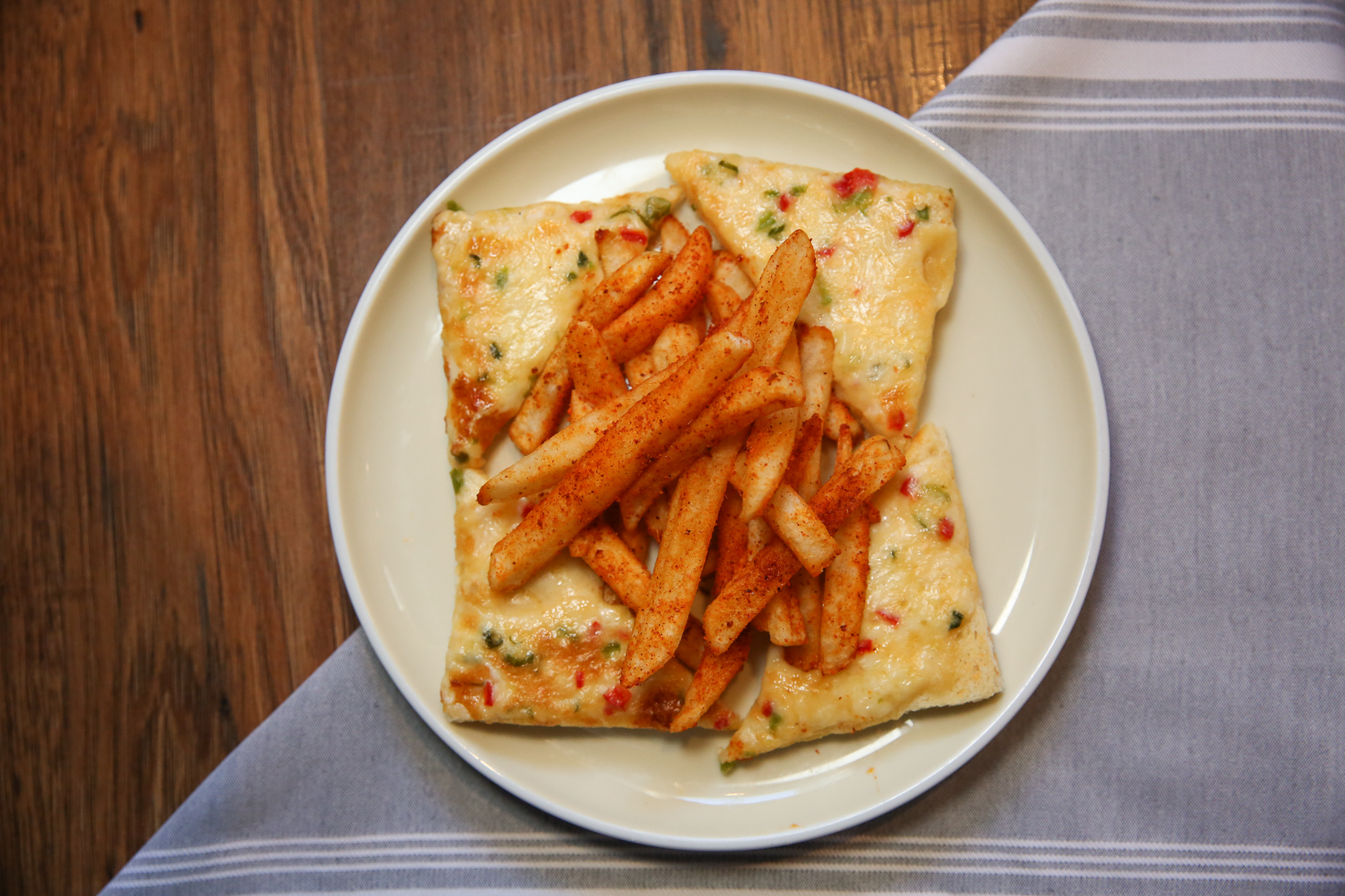 Chili cheese toast with gunpowder fries{ }(Image: Amanda Andrade-Rhoades/ DC Refined)