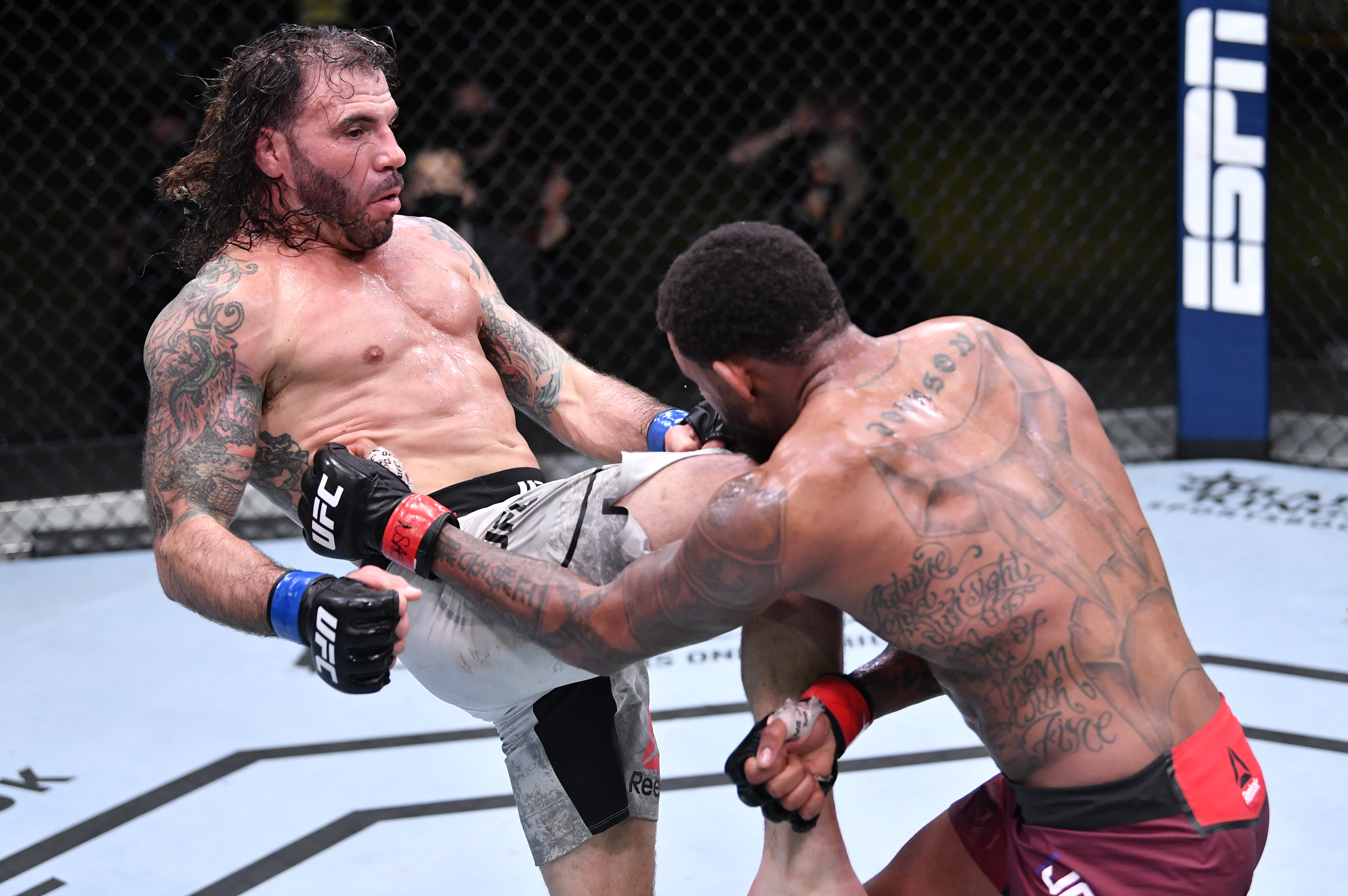 LAS VEGAS, NEVADA - FEBRUARY 06: In this handout image provided by UFC, (L-R) Clay Guida knees Michael Johnson in their lightweight fight during the UFC Fight Night event at UFC APEX on February 06, 2021 in Las Vegas, Nevada. (Photo by Chris Unger/Zuffa LLC via Getty Images)