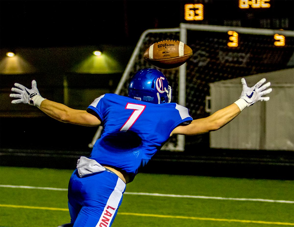 Churchill's Aidan Fox (#7) misses an interception in the end zone. Churchill defeated Crater 63-21 on Friday at their homecoming game. Churchill remains undefeated with a conference record of 9-0. Photo by August Frank, Oregon News Lab