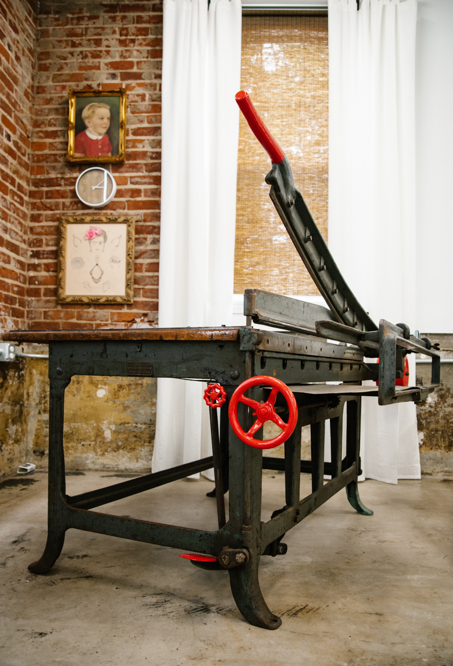 A 1,200-lb board shear from Massachusetts, made in 1900, graces a corner of the Strange Stock studio. Mueller painted the handles the bright red. / Image: Melissa Sliney{ }// Published: 9.7.19