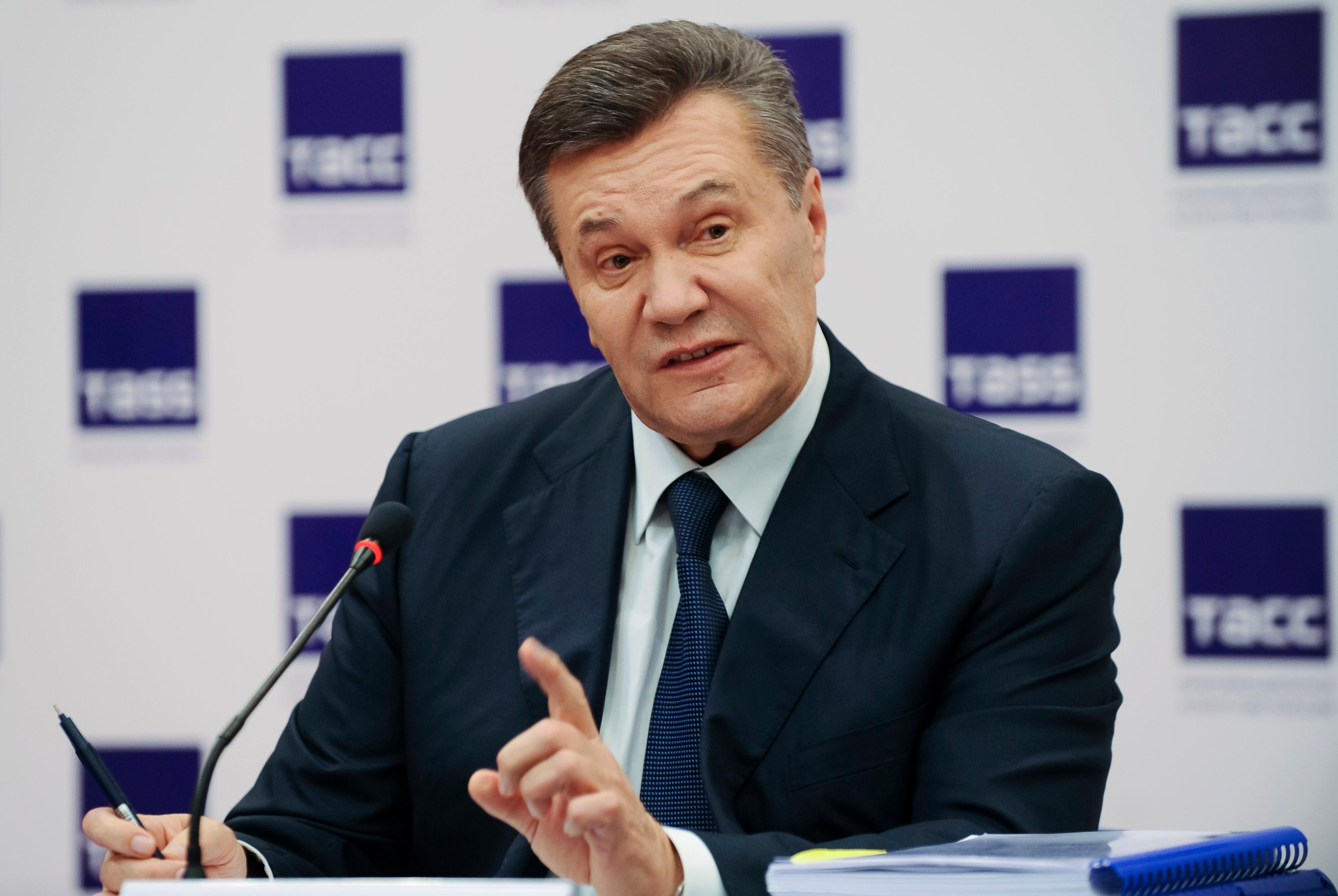 FILE - In this file photo dated Friday, Nov. 25, 2016, Ukraine's ousted president Viktor Yanukovych gestures as he speaks at a news conference in Rostov-on-Don, Russia.  Ukrainian opposition lawmaker Serhiy Leshchenko, who helped uncover off-the-books payments to President Donald Trump's former campaign chairman Paul Manafort, said Saturday Feb. 24, 2018, a one-time Austrian chancellor was among the European politicians secretly paid to lobby for Ukraine and its then president Yanukovych. (AP Photo, FILE)