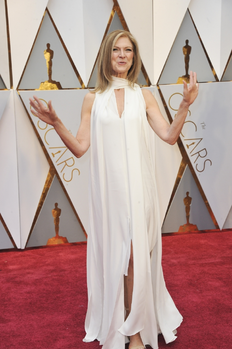"Looks a little bit like Dawn woke up on Oscars Day and realized she had forgotten to purchase a dress (or hire a stylist), threw on a bunch of white chiffon that she not so strategically cut up to create ""layers"" and called it a day. (Image: Apega/WENN.com)"