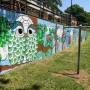 Mural at Cardinal Village brings brightness to the community