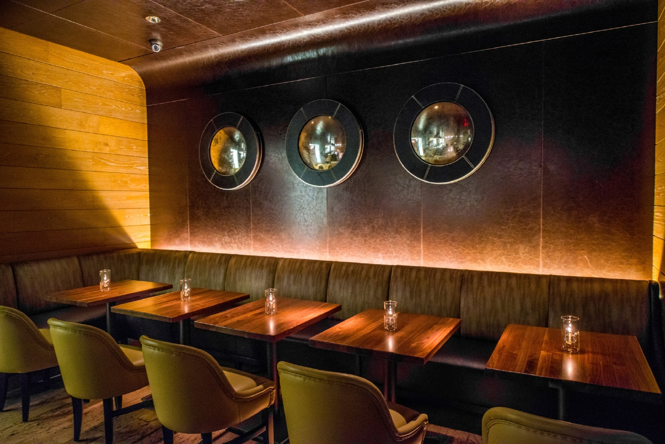 The 12-seat low-lit bar in Michael Mina's steakhouse in the the Georgetown Four Seasons mashes up old school (leather accents and a long bar) with modern lounge (comfy seating, booths and couches), says head bartender Torrence Swain. (Photo credit: Bourbon Steak)