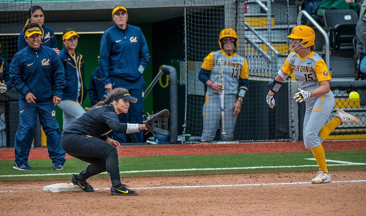 Oregon Ducks Mia Camuso (#7) attempts to get Cal Bears Lindsay Rood (#15) out at first base. The Oregon Ducks defeated the Cal Bears 2-1 in game two of a three-game series. Photo by Rhianna Gelhart, Oregon News Lab
