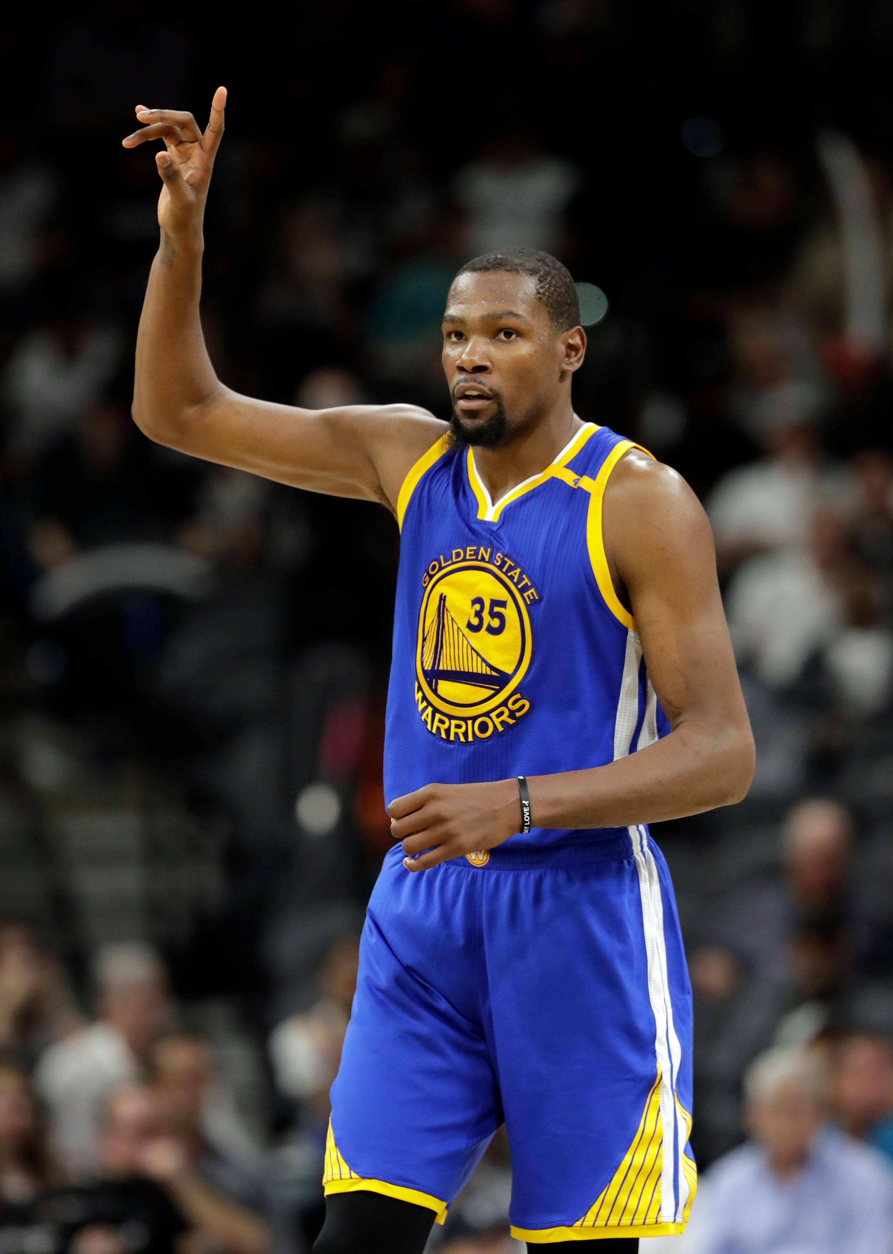 Golden State Warriors' Kevin Durant (35) celebrates a basket against the San Antonio Spurs during the second half in Game 4 of the NBA basketball Western Conference finals, Monday, May 22, 2017, in San Antonio. (AP Photo/Eric Gay)