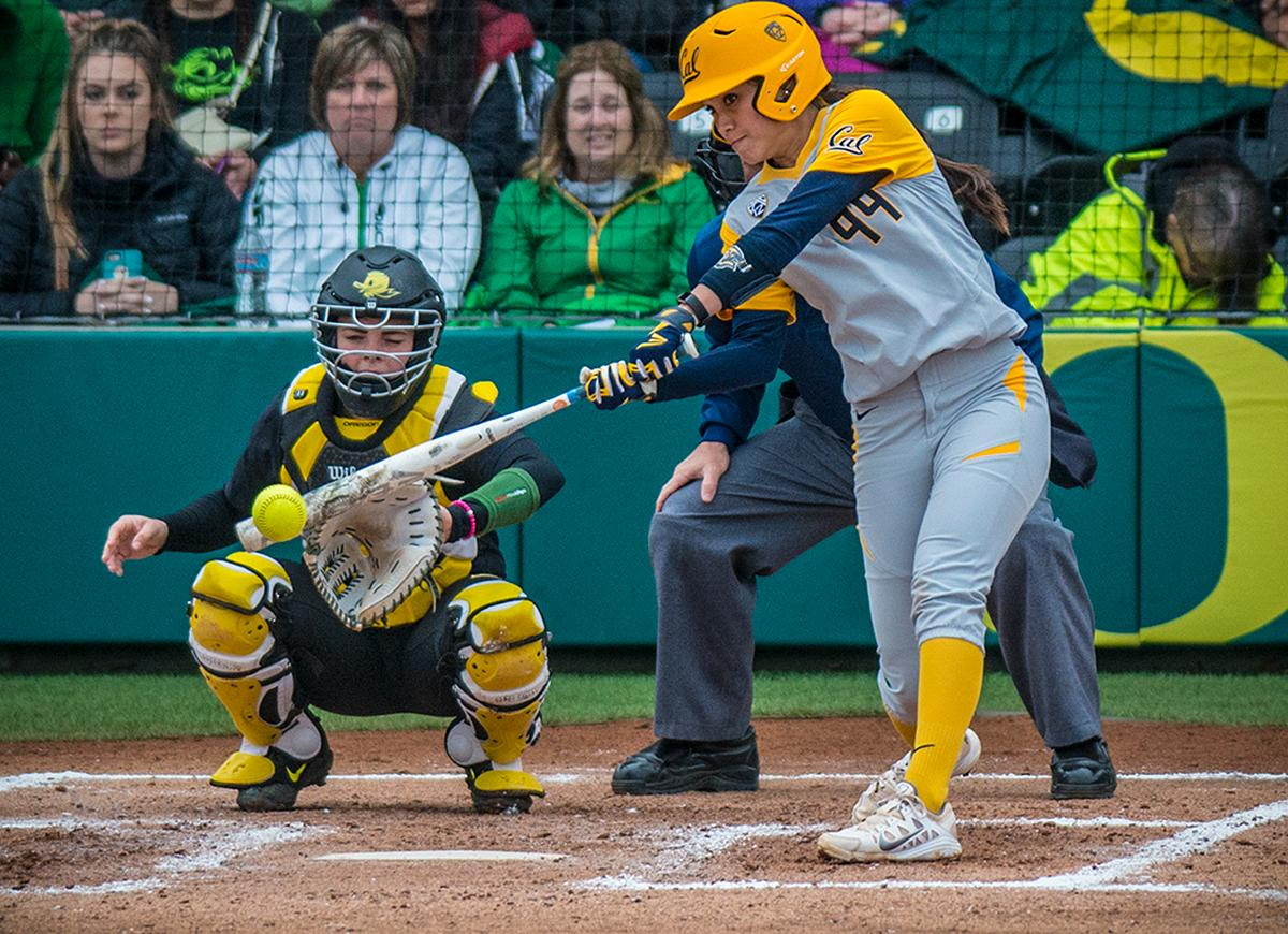 Cal Bears Alleah Laxamana (#99) swings for the ball. The Oregon Ducks defeated the Cal Bears 2-1 in game two of a three-game series. Photo by Rhianna Gelhart, Oregon News Lab