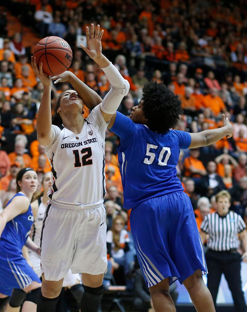Oregon State's Kolbie Orum (12) has her shot contested by Creighton's Brianna Rollerson during the second half of a second-round game in the NCAA women's college basketball tournament Sunday, March 19, 2017, in Corvallis, Ore. Oregon State won 64-52. (AP Photo/Timothy J. Gonzalez)