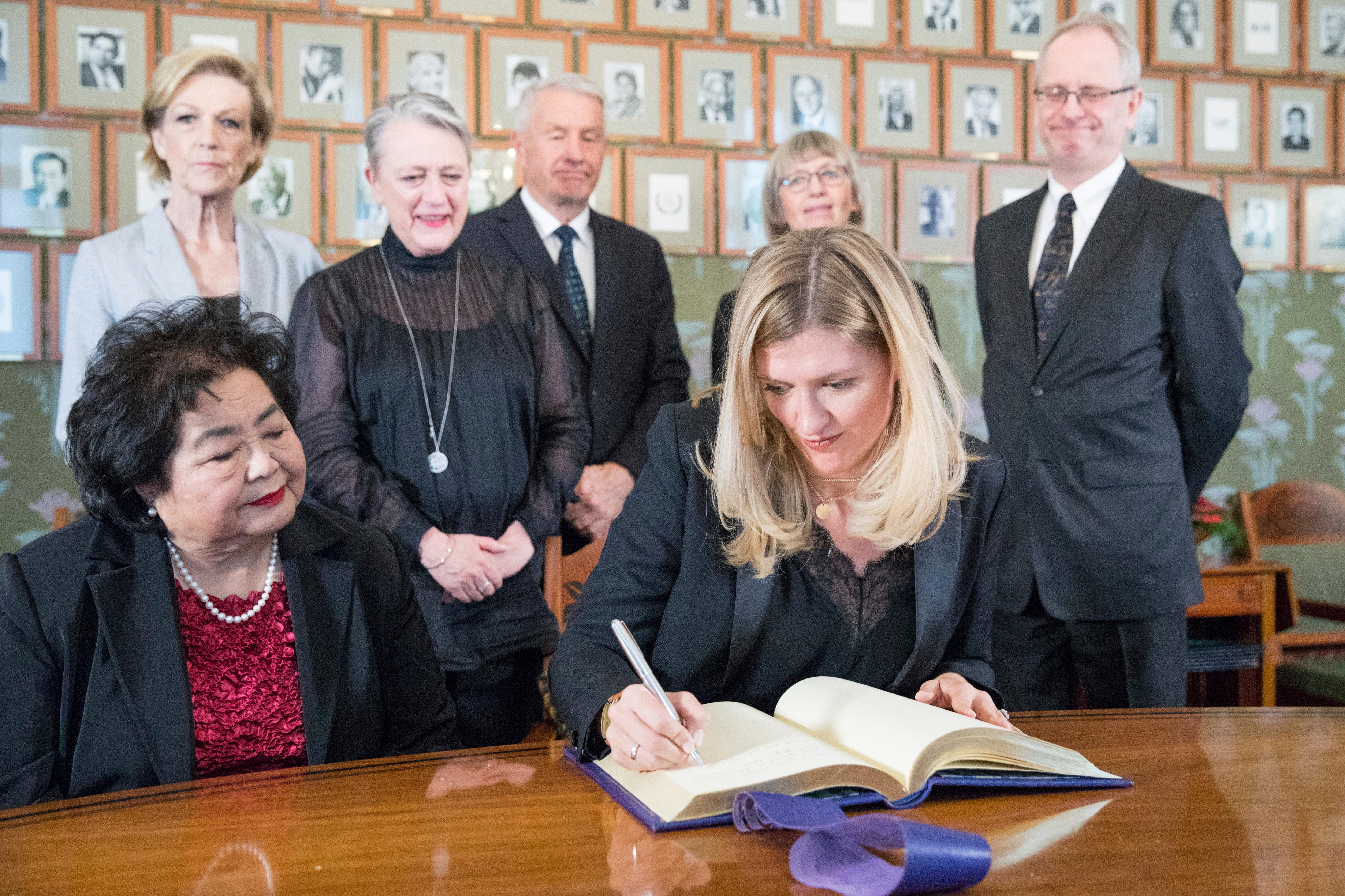 Executive Director of  ICAN (International Campaign to Abolish Nuclear Weapons), Beatrice Fihn signs the Nobel protocol, during a press conference at the Norwegian Nobel Committee, in Oslo, Norway, Saturday, Dec. 9, 2017. As long as atomic bombs exist, a disaster is inevitable, the head of the International Campaign to Abolish Nuclear Weapons, the winner of this year's Nobel Peace Prize, said Saturday. (Audun Braastad/NTB scanpix via AP)