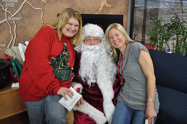 Gina and Denise getting in last minute requests with Santa