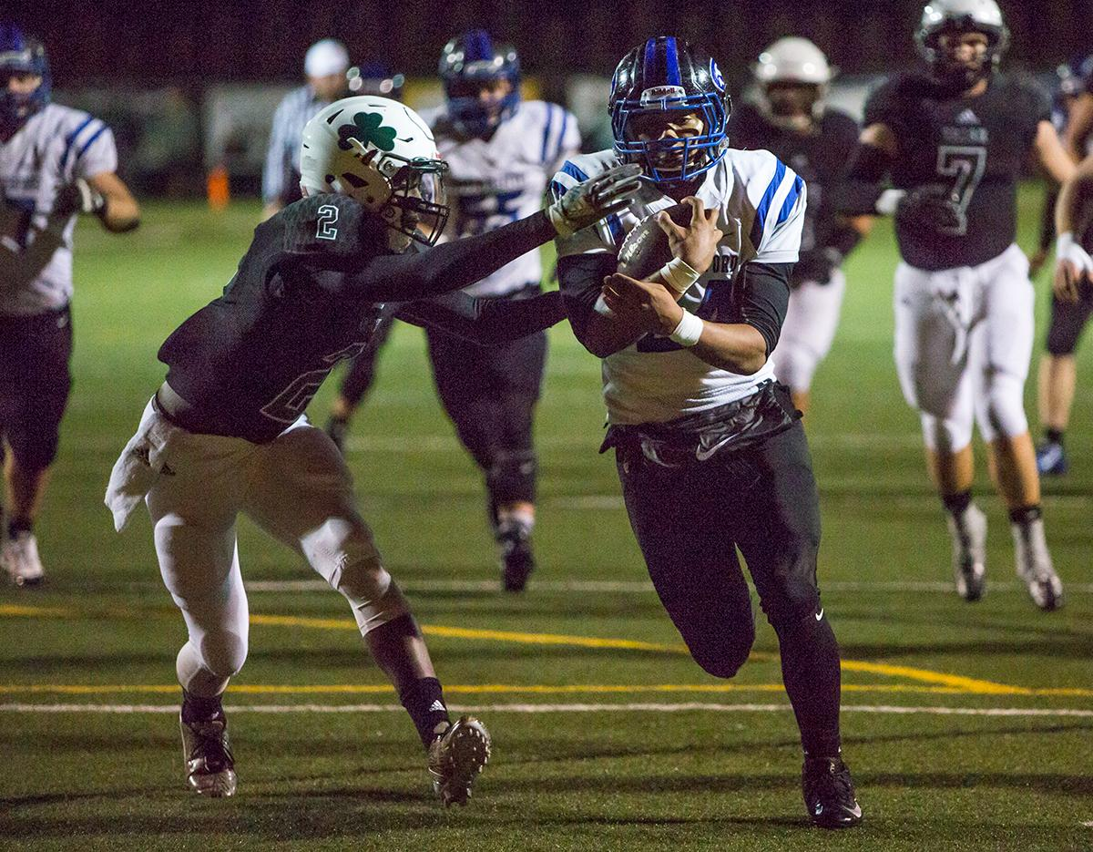 South Medford Panther Jaylin Parnell (#24) runs the ball into the end zone before Sheldon's Raymond Woodie (#2) can stop him. The South Medford Panthers defeated the Sheldon Irish 31 – 14 at Sheldon High School on Friday, October 20. Photo by Kit MacAvoy, Oregon News Lab