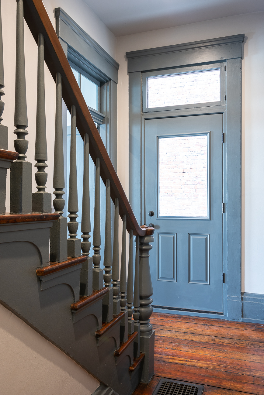 A staircase meets the front door to the breezeway. / Image: Phil Armstrong, Cincinnati Refined // Published: 3.15.19