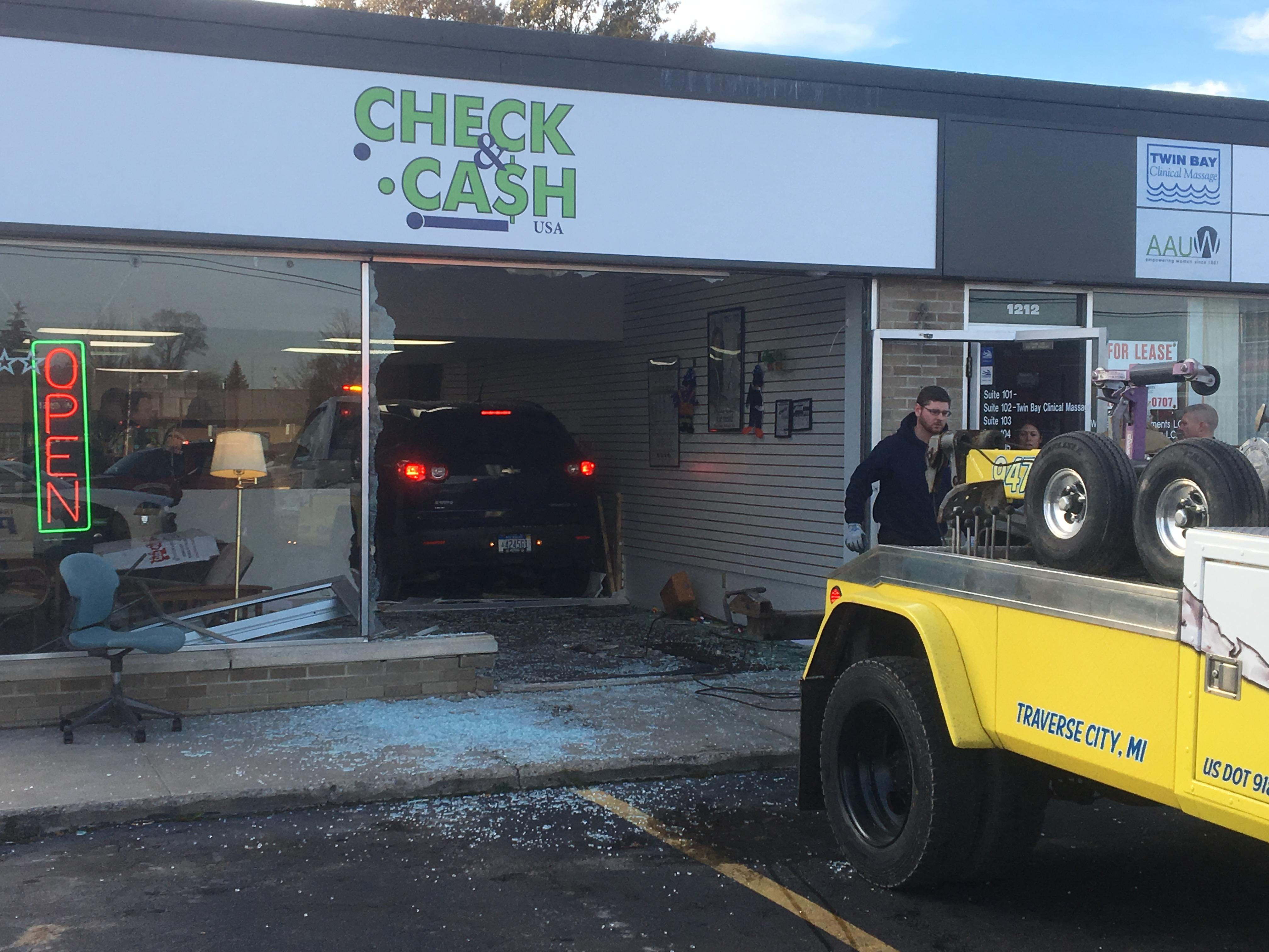 <p>Police are at the scene of a vehicle that crashed into a Traverse City business. It happened around 3:30 p.m. Monday at the Check &amp;amp; Cash on South Garfield and Baldwin.</p>