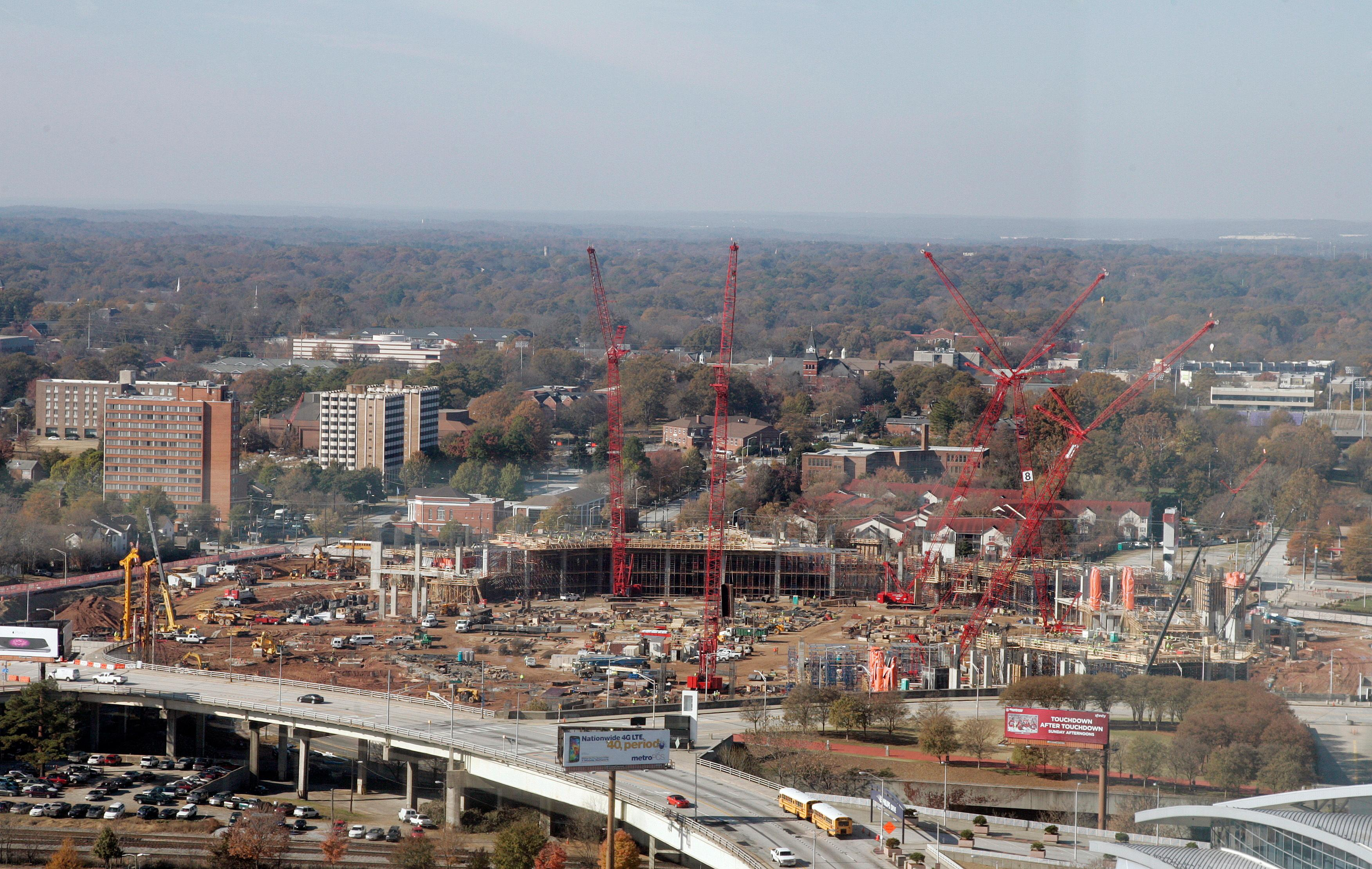 In this Nov. 20, 2014 photo, construction crews work on the the Mercedes-Benz stadium, in Atlanta. The facility is the new home of the National Football League's Atlanta Falcons and Major League Soccer's Atlanta United. (AP Photo/John Bazemore)
