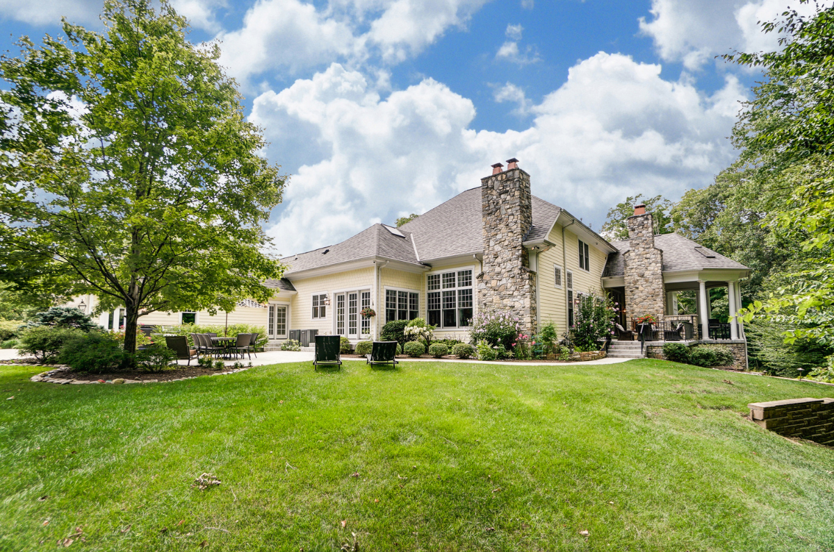 <p>The grounds are beautifully landscaped, and everywhere you look you'll see trees. A huge covered porch, multiple patios and comfortable outdoor nooks, as well as a rolling green lawn will let you, your guests, your kids, and your pets enjoy the surrounding nature. And a four-car garage completes the package. / Image courtesy of Wow Video Tours via Michael Franz of Coldwell Banker West Shell-Hyde Park // Published: 9.7.20</p>