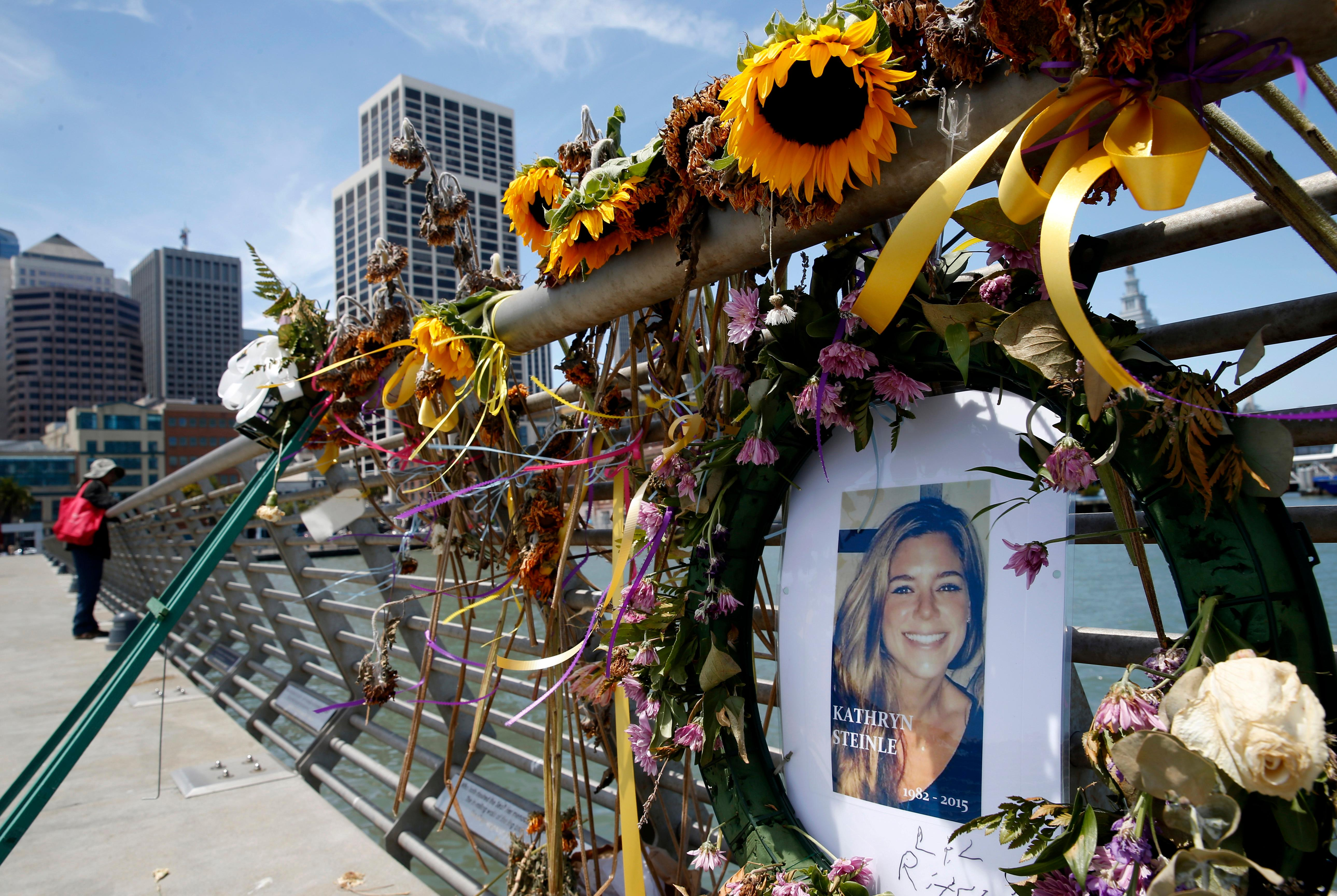 FILE - In this July 17, 2015 file photo, flowers and a portrait of Kate Steinle remain at a memorial site on Pier 14 in San Francisco. Jurors ended their fifth day of deliberations Wednesday, Nov. 29, 2017, without reaching a verdict in the murder trial that sparked a national debate over immigration policy. The six men and six women are deciding whether Jose Ines Garcia Zarate meant to shoot Steinle as charged or whether they believe his claim that the the shooting was accidental. (Paul Chinn/San Francisco Chronicle via AP, File)