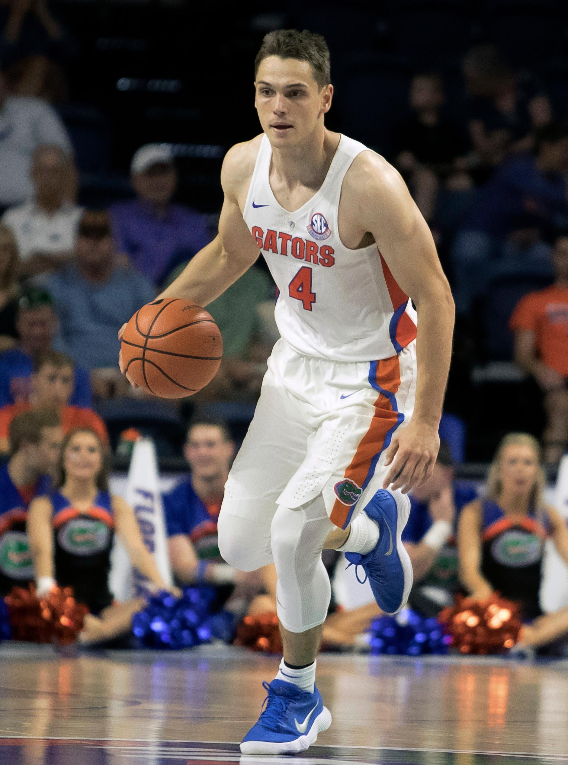 FILE - In this Nov. 5, 2017, file photo, Florida guard Egor Koulechov (4) dribbles against during the second half of an NCAA college exhibition basketball game in Gainesville, Fla. A few of last year's Final Four teams have added transfers to help restock their rosters. Florida added Koulechov and Jalen Hudson. (AP Photo/Ron Irby, File)