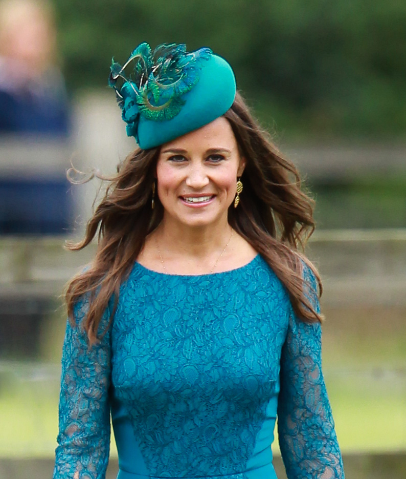 Pippa Middleton attends the wedding of James Meade and Lady Laura Marsham at St Nicholas' Church in Gayton (WENN.com)