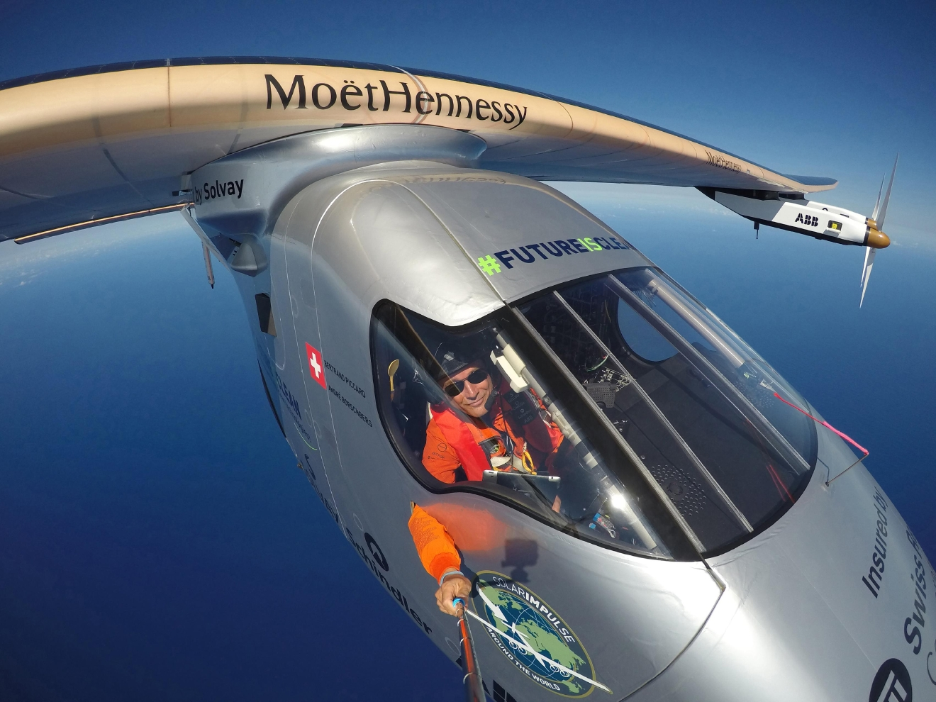 This April 9, 2016 photo provided by Bertrand Piccard via Global Newsroom shows Piccard taking a selfie on board Solar Impulse 2 during a test flight over the Pacific Ocean.  The solar-powered airplane on an around-the-world journey had traveled 80 percent of the way from Hawaii to California by Saturday, April 23.  The aircraft's destination on this leg of the journey is Mountain View, Calif., at the southern end of San Francisco Bay.  (Bertrand Piccard/Global Newsroom via AP)