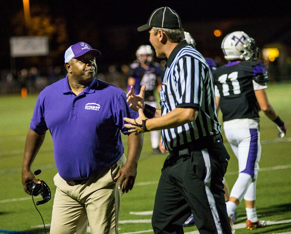 South Eugene Axemen Coach Kevin Leonard is ejected from the game after disputing a call. Sheldon Irish defeated South Eugene Axemen 63-6 on Friday night at South Eugene Highschool in Eugene, Ore. Photo by Rhianna Gelhart, Oregon News Lab