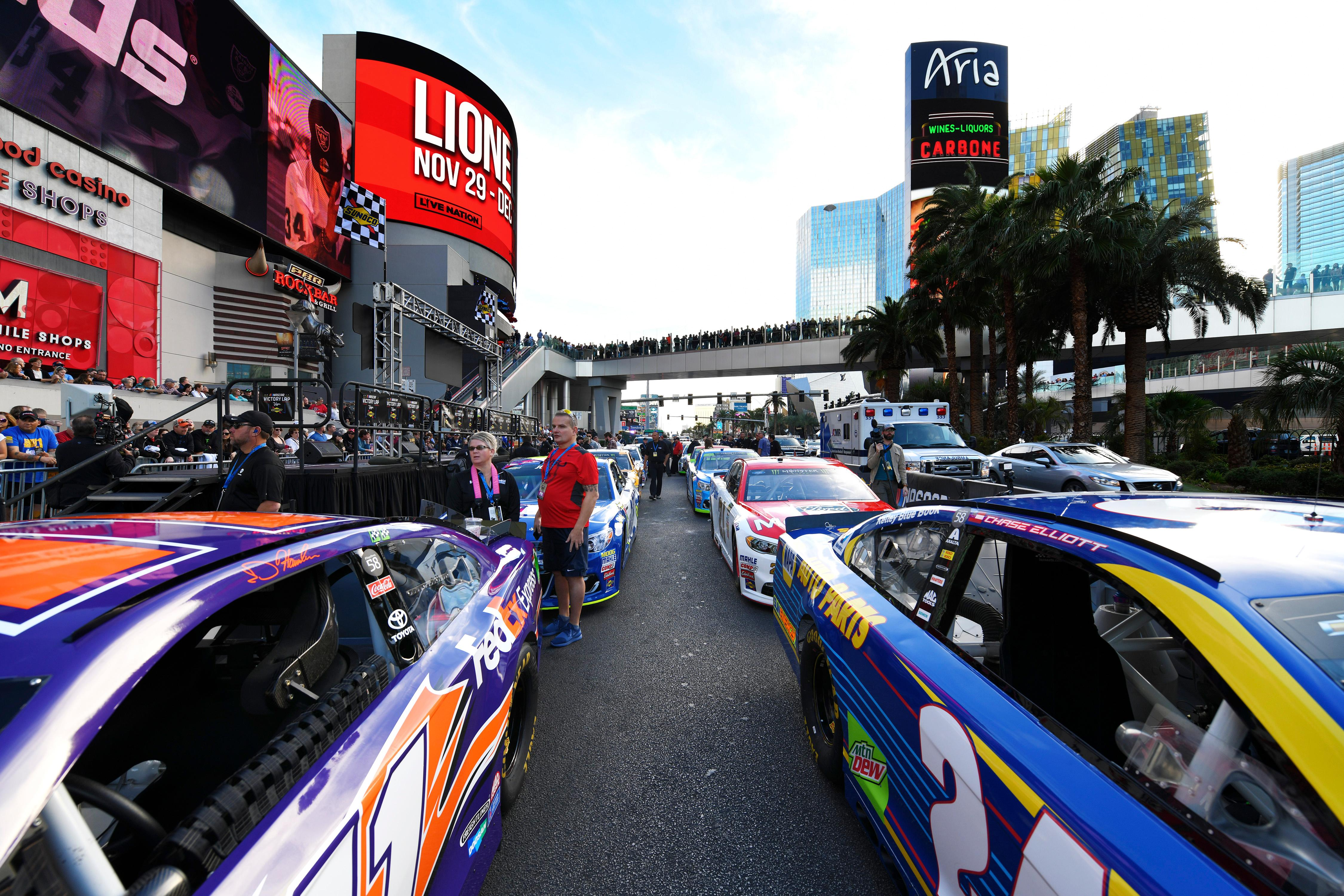 Stock cars are lined up outside Planet Hollywood and the Miracle Mile Shops during the NASCAR Victory Lap on the Las Vegas Strip being held as part of Champions Week Wednesday, November 29, 2017. CREDIT: Sam Morris/Las Vegas News Bureau