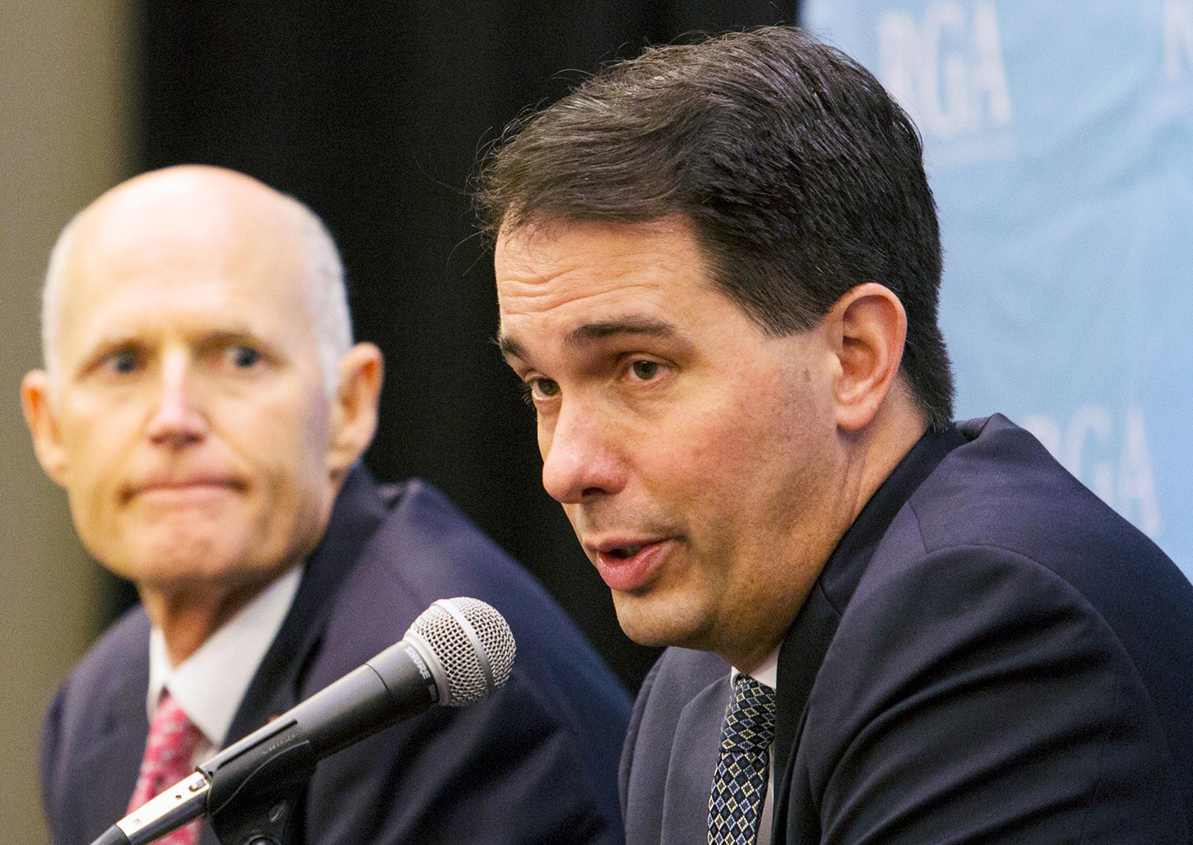 FILE - In this Nov. 15, 2017, file photo, Wisconsin Gov. Scott Walker answers questions during the Republican Governors Association's Annual Conference in Austin, Texas. The Trump administration's decision to allow states to make a work a requirement for Medicaid is being cheered by Republican leaders who say the limit is needed to curb a program that was originally intended to get people back on their feet. Walker, an ally of Trump's, sought federal approval for a work requirement last year and said it helps prepare recipients to leave public assistance. (Ana Ramirez/Austin American-Statesman via AP, File)