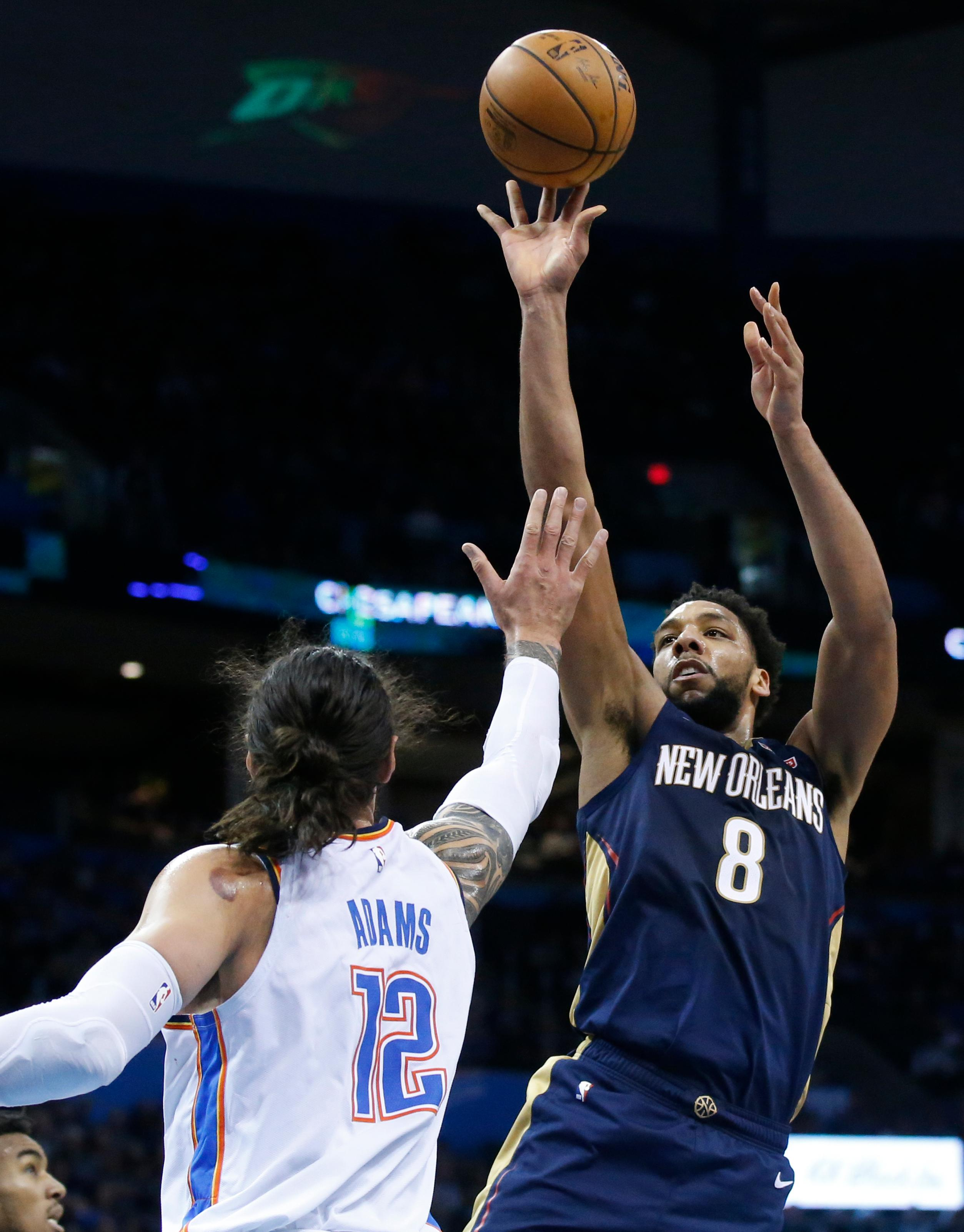 New Orleans Pelicans center Jahlil Okafor (8) shoots over Oklahoma City Thunder center Steven Adams (12) during the first half of an NBA basketball game in Oklahoma City, Thursday, Jan. 24, 2019. (AP Photo/Sue Ogrocki)