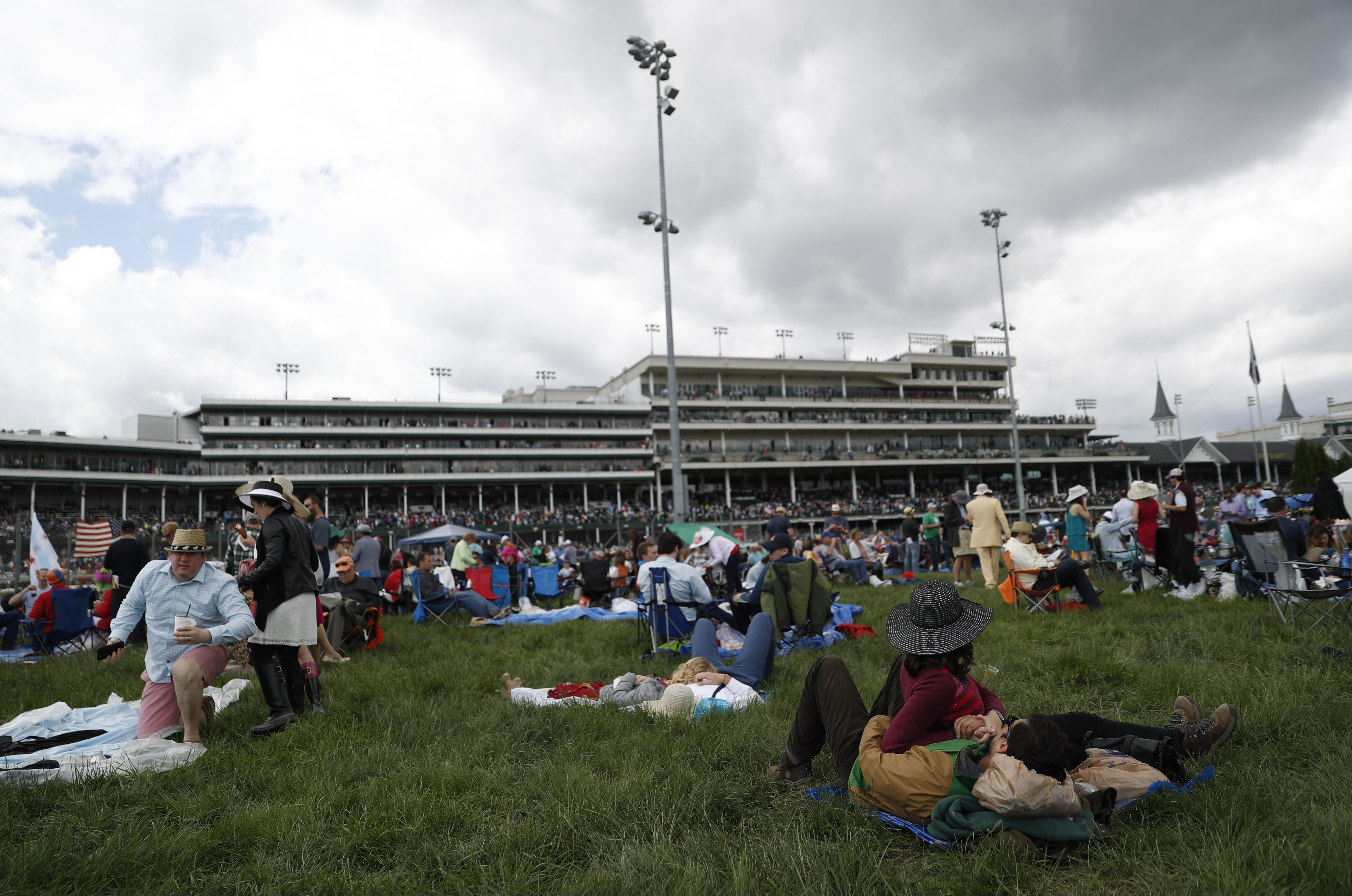 Fans wait for the start of the 143rd running of the Kentucky Derby horse race at Churchill Downs Saturday, May 6, 2017, in Louisville, Ky. (AP Photo/John Minchillo)