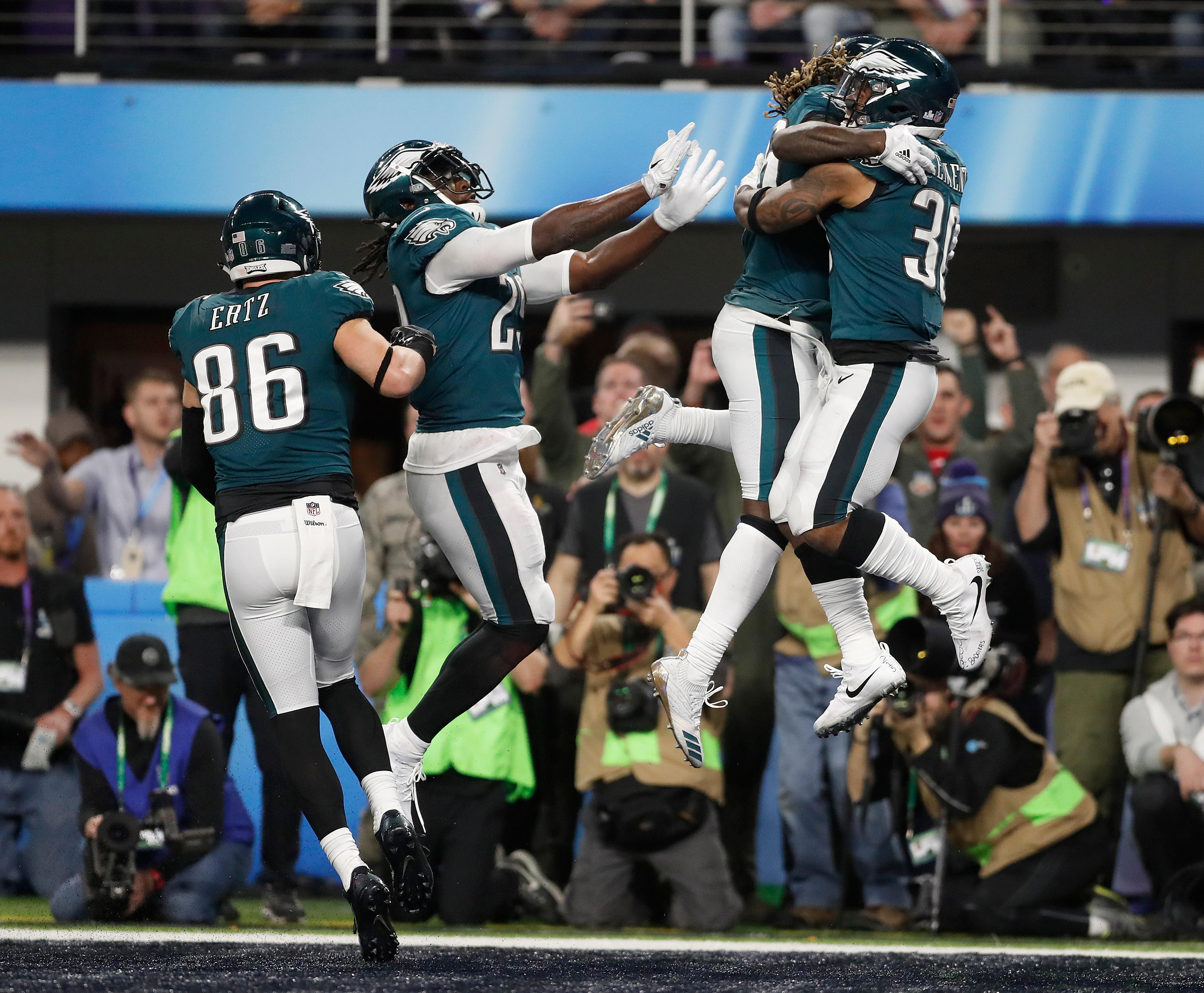 Philadelphia Eagles' Corey Clement, right, celebrates his touchdown catch during the second half of the NFL Super Bowl 52 football game against the New England Patriots Sunday, Feb. 4, 2018, in Minneapolis. (AP Photo/Jeff Roberson)