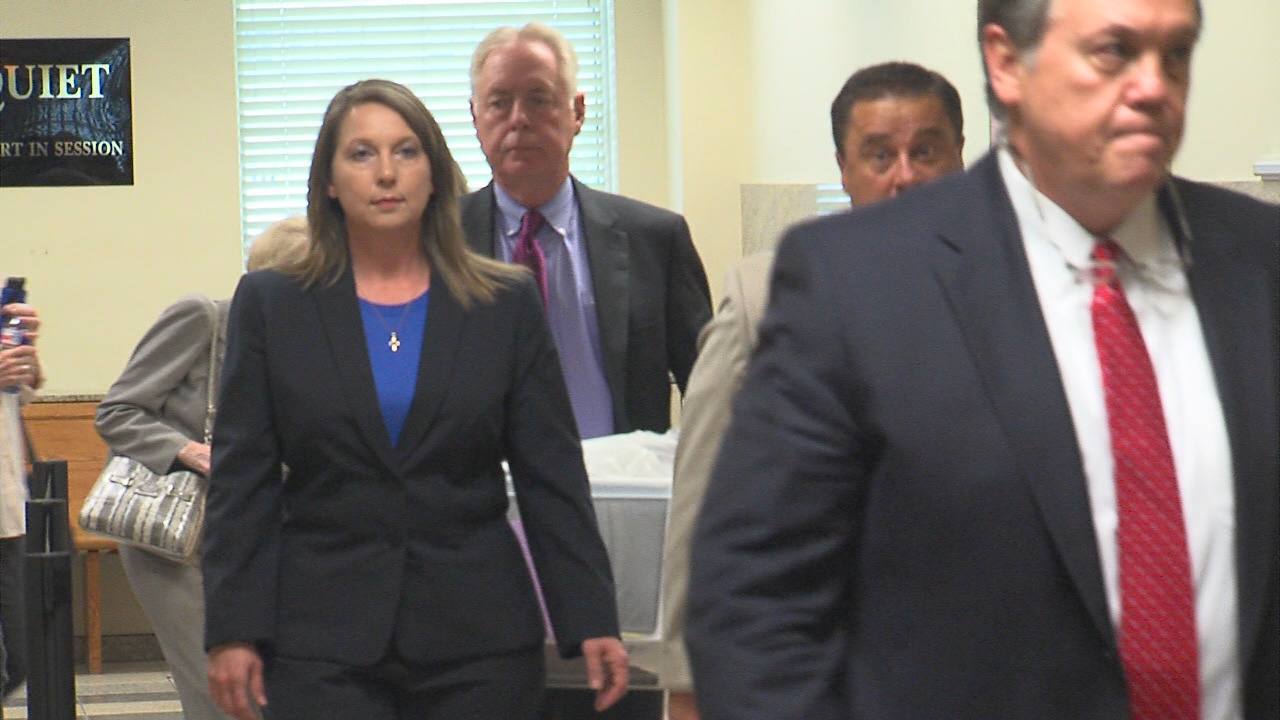 Betty Shelby leaves the courtroom on day three of her manslaughter trial, the first day of testimony. (KTUL)