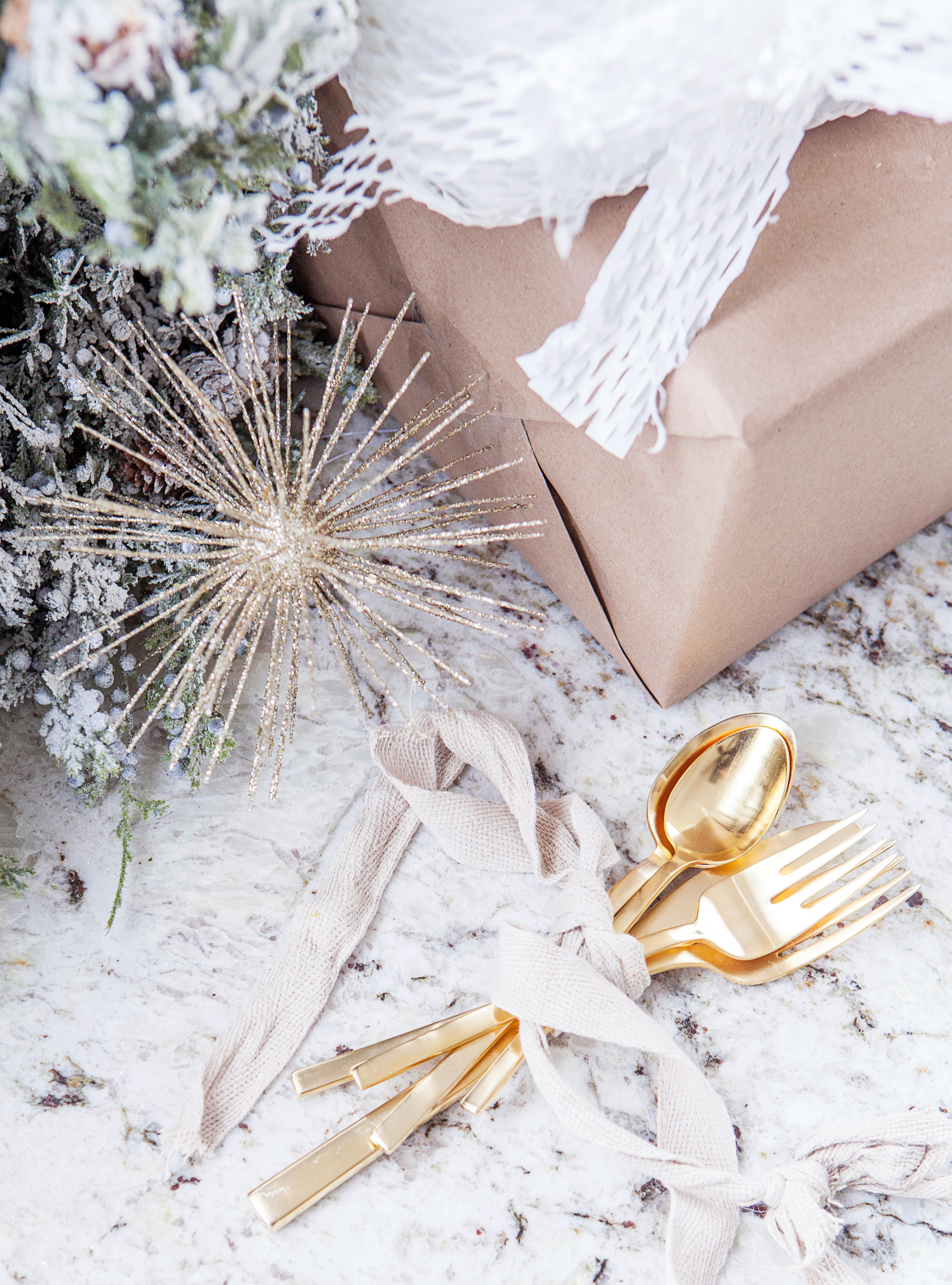 Who doesn't need a bit of shimmer on their holiday table? West Elm has got the most beautiful gold flatware that is the perfect accent to any table all year long. (Image: Ashley Hafstead)