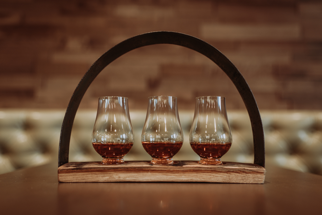 A bourbon flight on a Boone County Distilling barrel custom-made flight holder / Image: Brianna Long // Published: 5.17.18