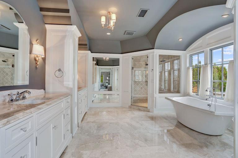 The master bathroom features dual vanities, a steam shower and a vbessel tub overlooking the backyard. (Image: Courtesy HomeVisit)<p></p>