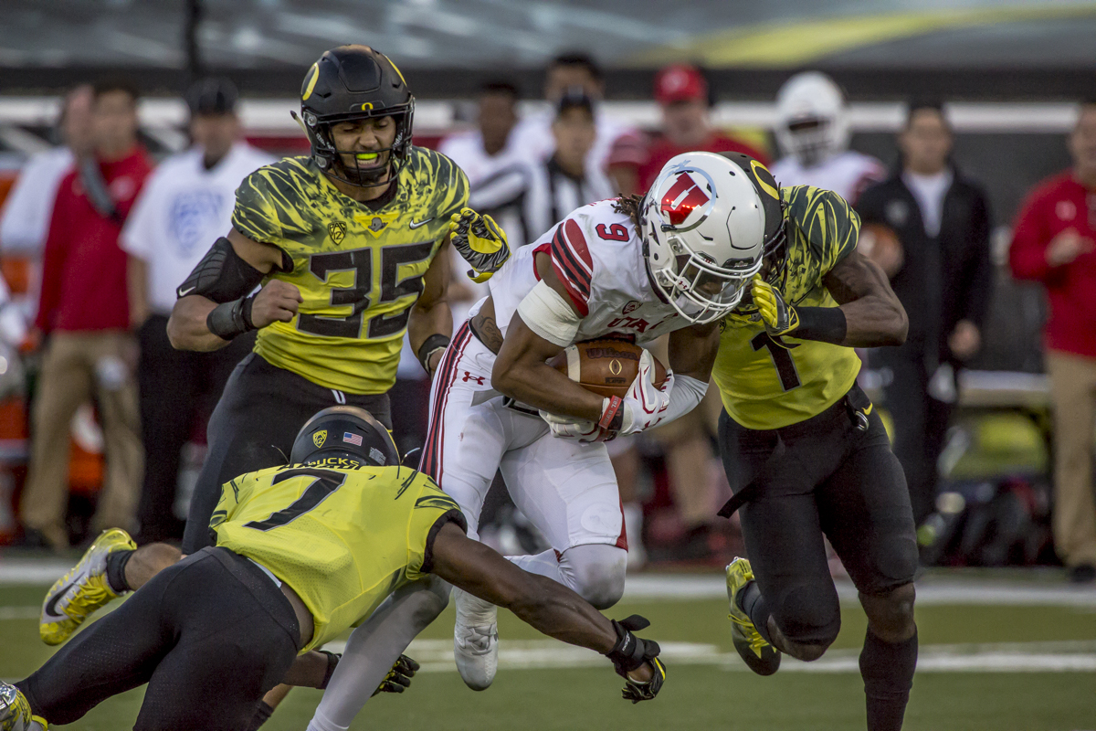 The Oregon defense brings down Utah wide receiver Darren Carrington III (#9). The Oregon Ducks defeated the Utah Utes 41 to 20 during Oregon's homecoming game at Autzen Stadium on Saturday, October 28, 2017. Photo by Ben Lonergan, Oregon News Lab