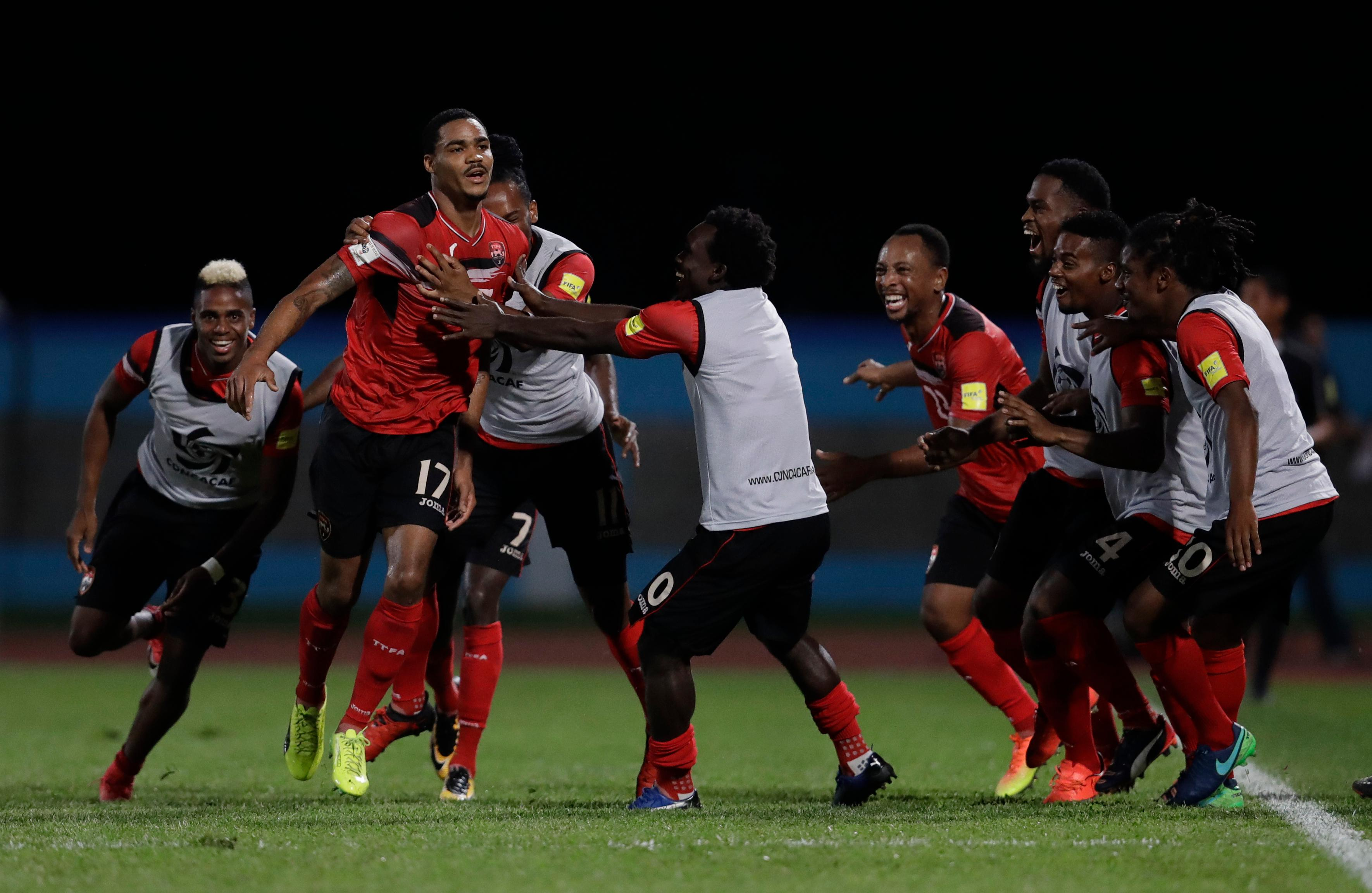 Trinidad and Tobago's Alvin Jones (17) celebrates with his teammates after scoring against U.S. during a World Cup qualifying soccer match in Couva, Trinidad, Tuesday, Oct. 10, 2017. (AP Photo/Rebecca Blackwell)
