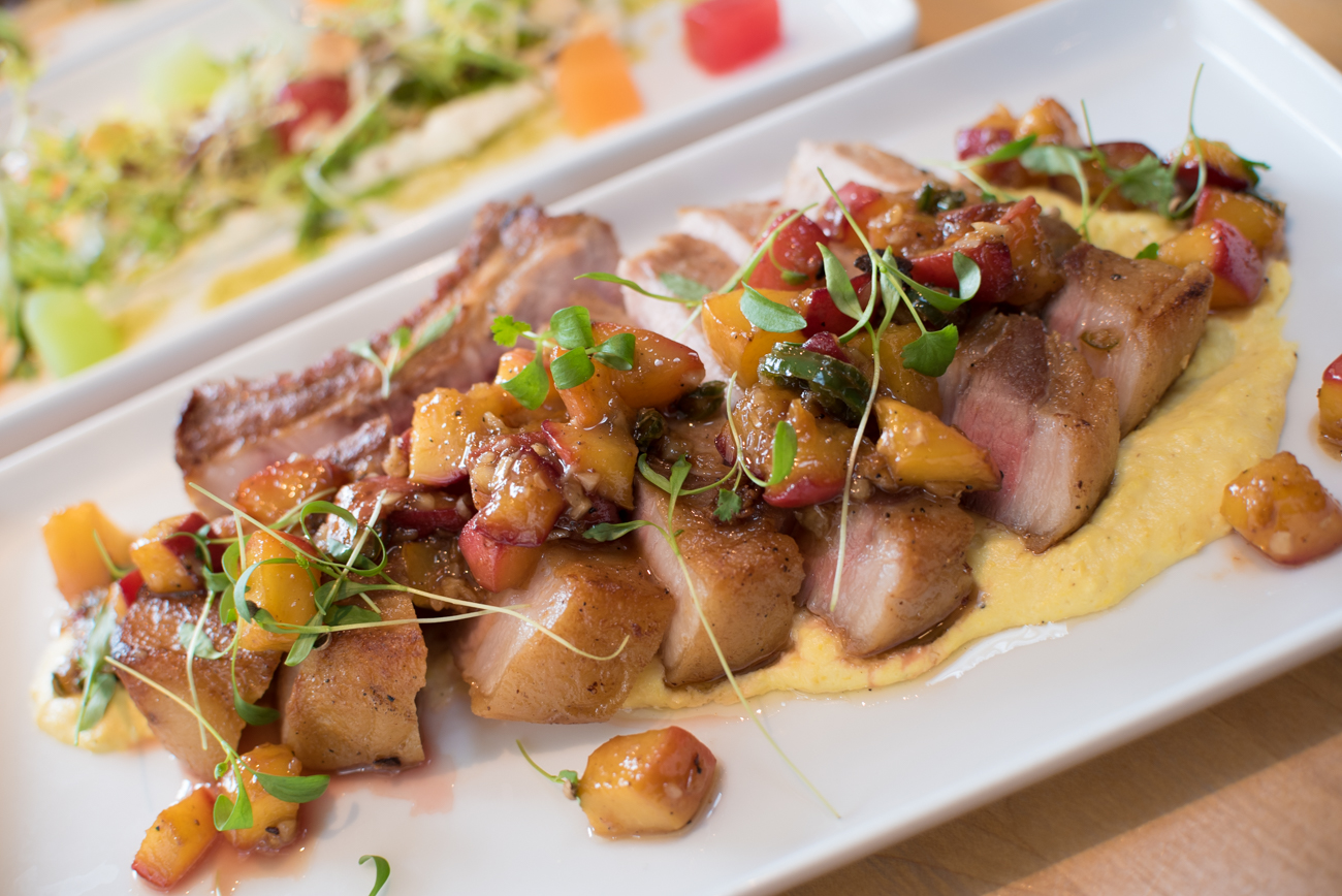 Grilled porkchop with sweet corn puree, sauteed peaches, brandy, and serrano / Image: Phil Armstrong // Published: 9.9.17