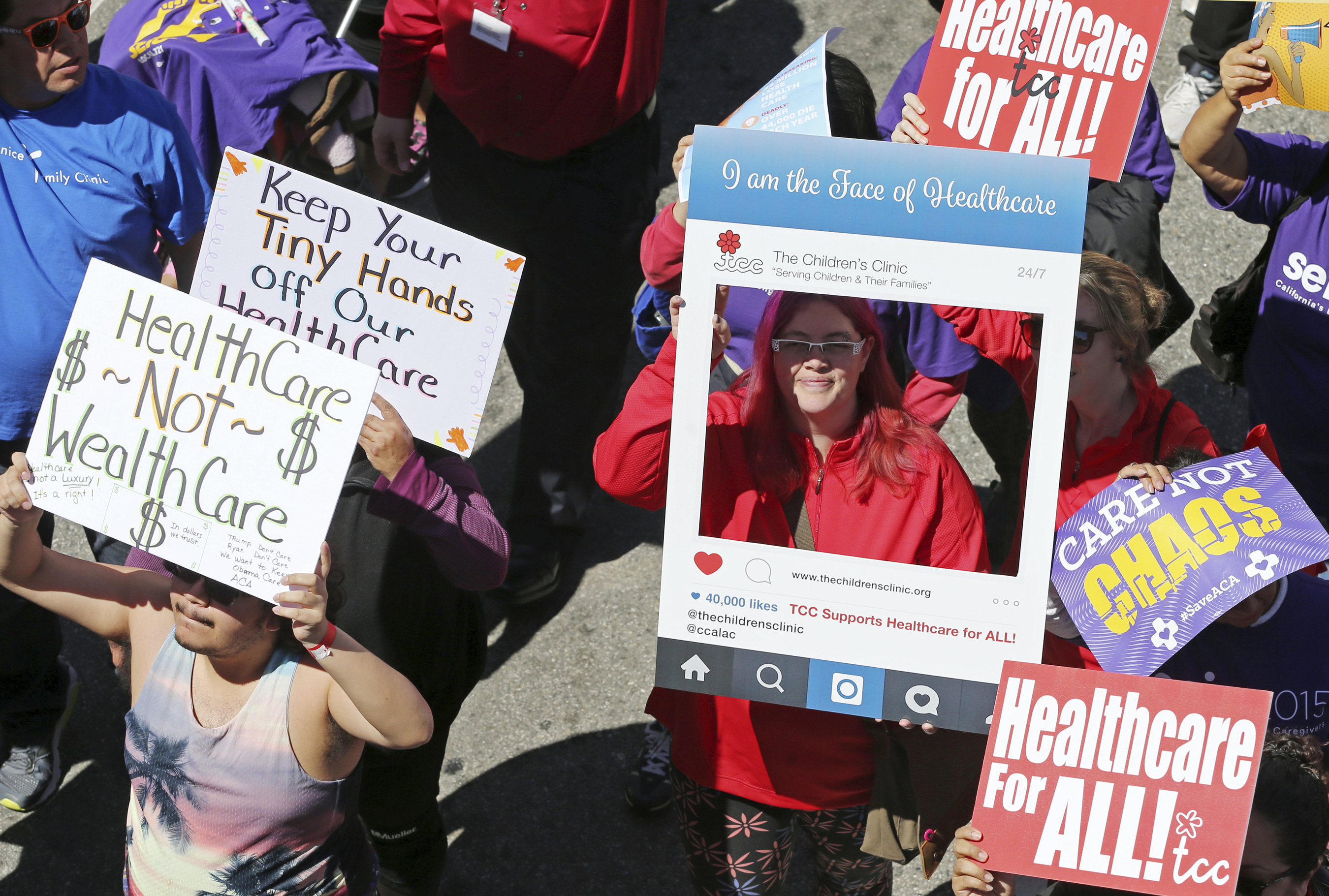 FILE - In this March 23, 2017, file photo, hundreds of people march through downtown Los Angeles protesting President Donald Trump's plan to dismantle the Affordable Care Act, his predecessor's signature health care law. Health care proposals are among the first actions for some new Democratic governors and Democratically controlled legislatures. Expanding access to care was a rallying point for the party in the 2018 elections. The early proposals fall short of universal health care but are generally seen as steps that will get states closer to full health coverage for their residents.   (AP Photo/Reed Saxon, File)