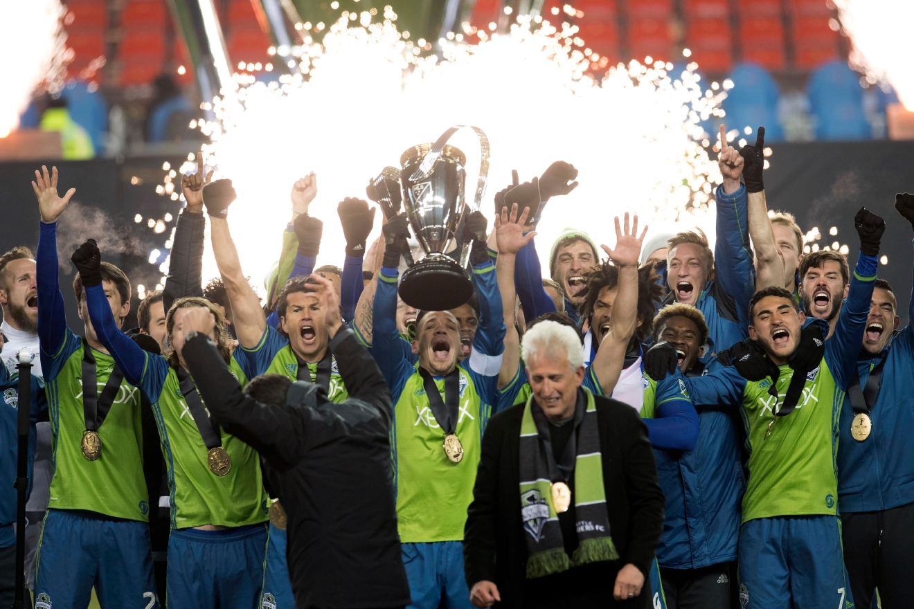 Members of the Seattle Sounders celebrate after winning the MLS Cup over Toronto FC in Toront Saturday, Dec. 10, 2016. (Frank Gunn/The Canadian Press via AP)