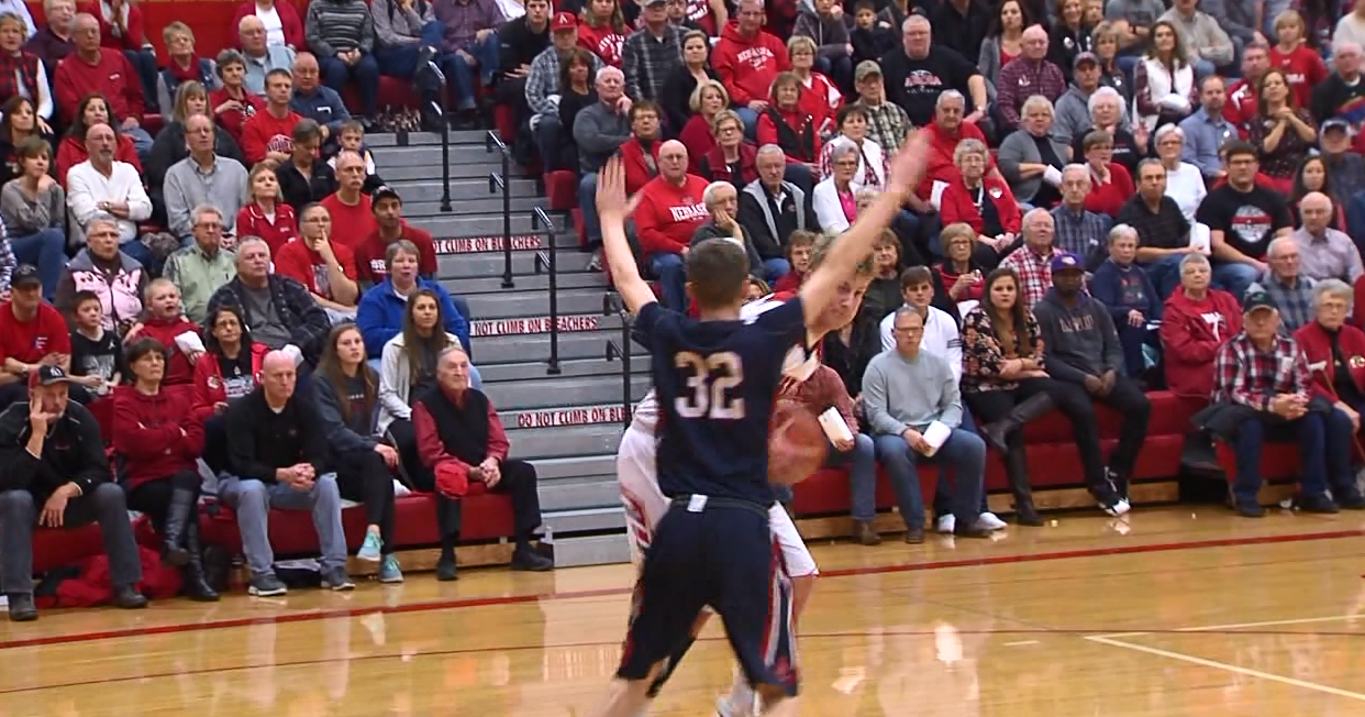 Aurora's Henry Penner gets the ball in the lane and prepares to shoot during a game against Adams Central. (NTV News)