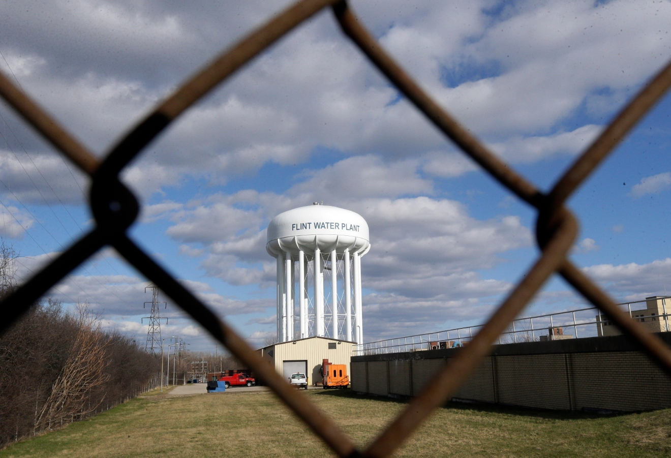 FILE - This March 21, 2016 file photo shows the Flint Water Plant water tower in Flint, Mich. Michigan Gov. Rick Snyder is calling for a halt of administrative investigations into how two state agencies dealt with the Flint drinking water crisis after being warned they are hampering state and federal criminal probes. Snyder's office released letters Thursday May 26, 2016, from the state attorney general and a federal prosecutor. (AP Photo/Carlos Osorio File)