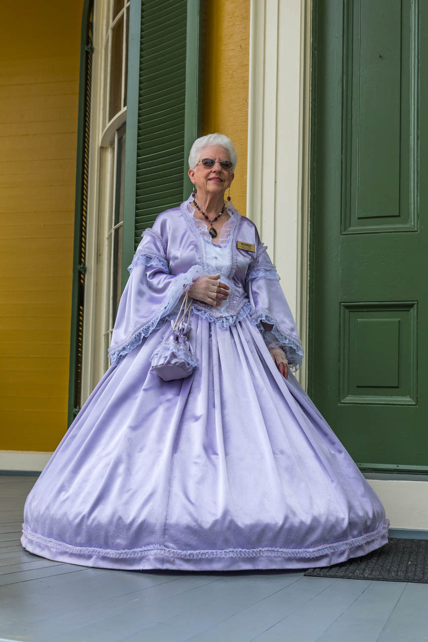Suzanne Ullrich, Head Docent, wears a Victorian-era dress. / Image: Mike Menke // Published: 6.7.18