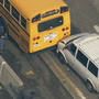 Man in custody after van rams school bus, State Patrol car on I-5