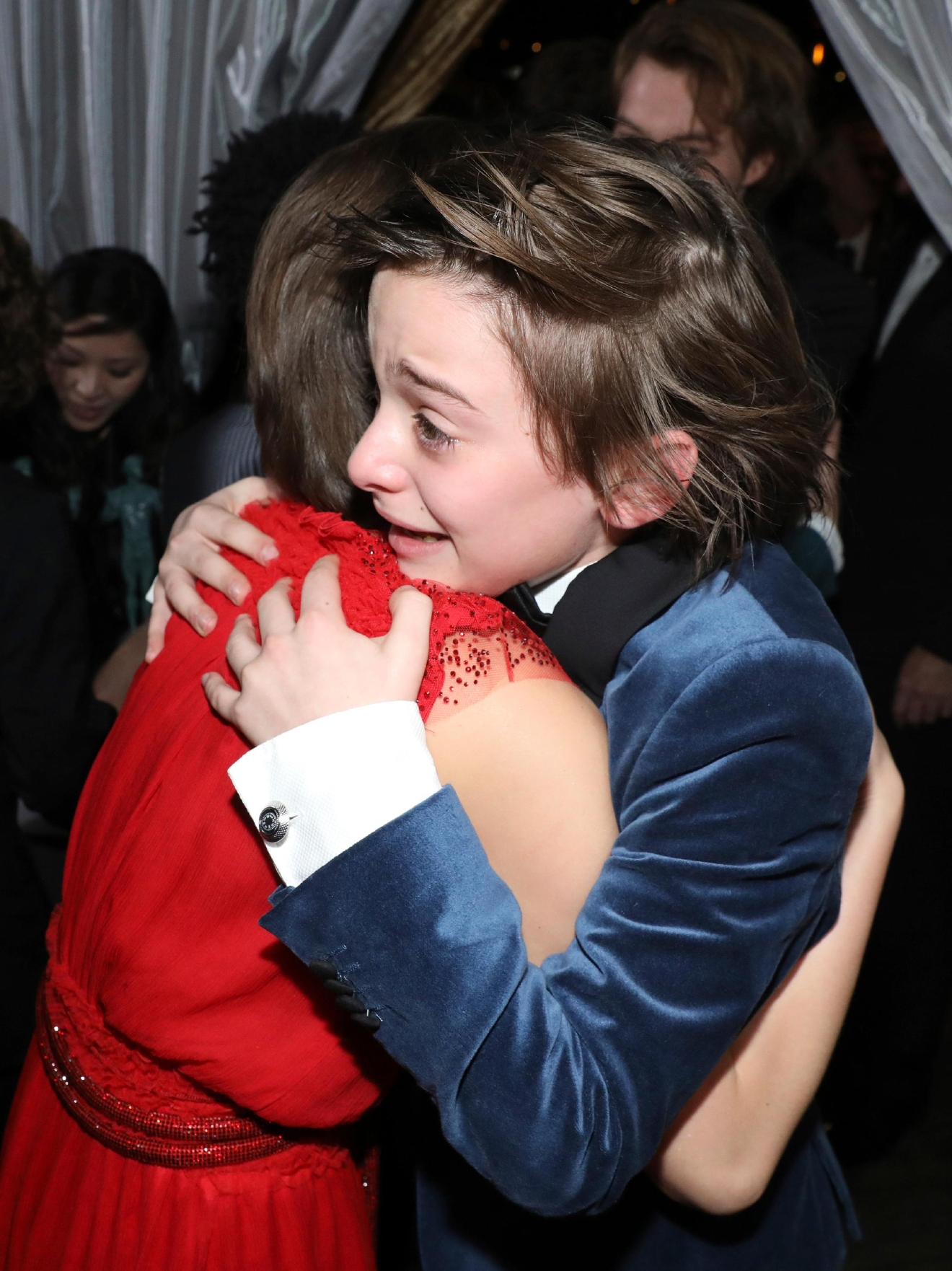 "Millie Bobby Brown, left, and Noah Schnapp embrace backstage after winning the award for outstanding performance by an ensemble in a drama series for ""Stranger Things"" at the 23rd annual Screen Actors Guild Awards at the Shrine Auditorium & Expo Hall on Sunday, Jan. 29, 2017, in Los Angeles. (Photo by Matt Sayles/Invision/AP)"