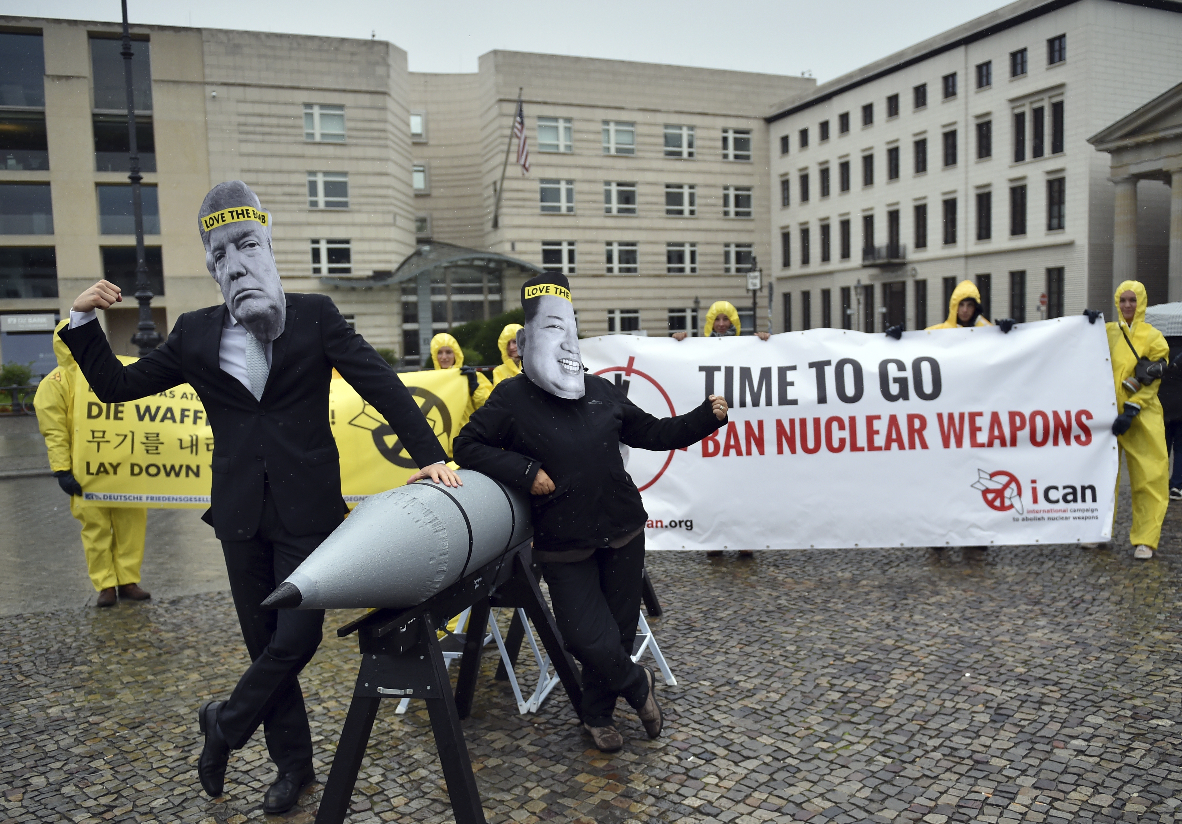 FILE - in this Sept. 13, 2017 file photo activists of the International Campaign to Abolish Nuclear Weapons (ICAN) protest against the conflict between North Korea and the USA with masks of the North Korean ruler Kim Jong Un, right, and the US president Donald Trump, left, in front of the US embassy in Berlin, Germany.{&amp;nbsp;} (Britta Pedersen/dpa via AP)<p></p>