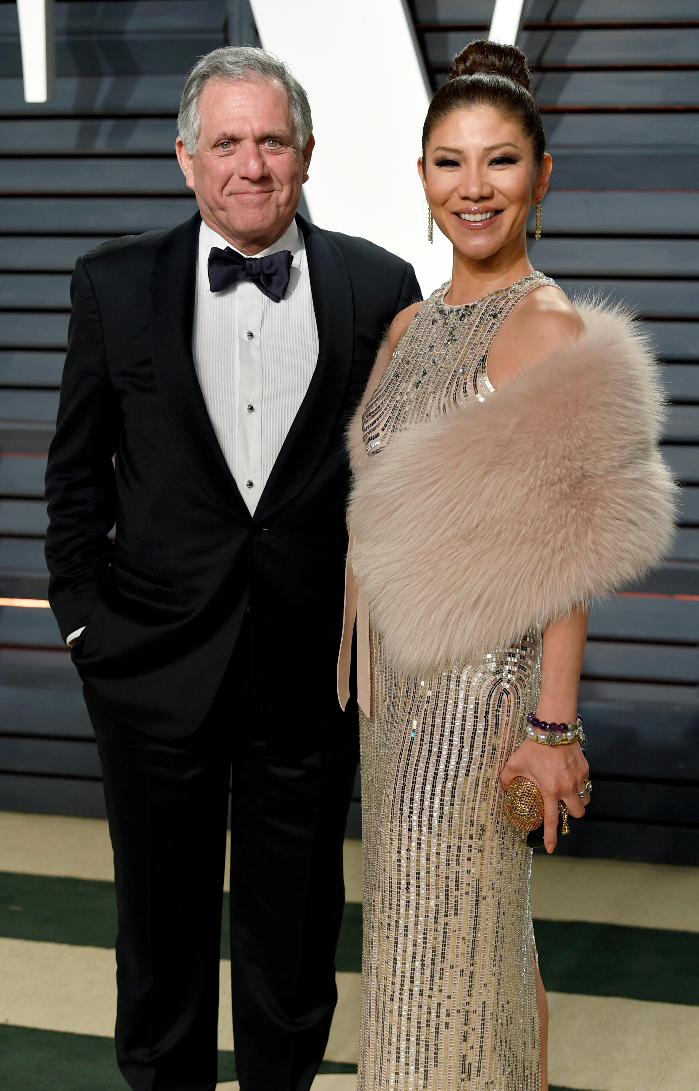 "FILE - In this Feb. 26, 2017 file photo, Les Moonves, left, and Julie Chen arrive at the Vanity Fair Oscar Party in Beverly Hills, Calif. Chen was absent from her talk CBS show, ""The Talk"" a day after a new round of sexual misconduct allegations against Moonves brought the departure of the CBS chief executive. In what was supposed to be a celebratory season premiere Monday, Sept. 10, 2018, the show's four other panelists walked out somberly without Chen, who acts as host and moderator. Sharon Osbourne choked back tears as she announced Chen would be taking time off to be with her family, and expressed support for her co-star and friend. (Photo by Evan Agostini/Invision/AP, File)"